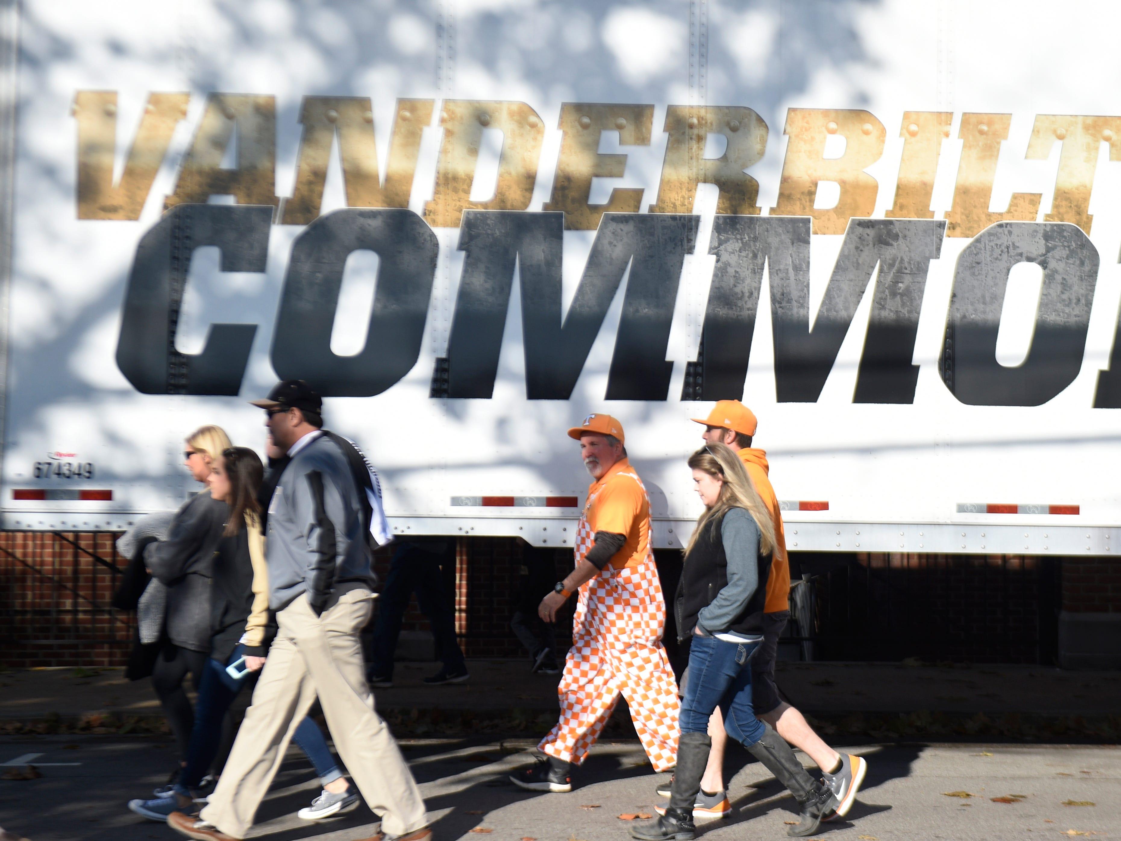 Vols fans walk past a Vandy sign before the game at Vanderbilt Stadium Saturday, Nov. 24, 2018, in Nashville, Tenn.