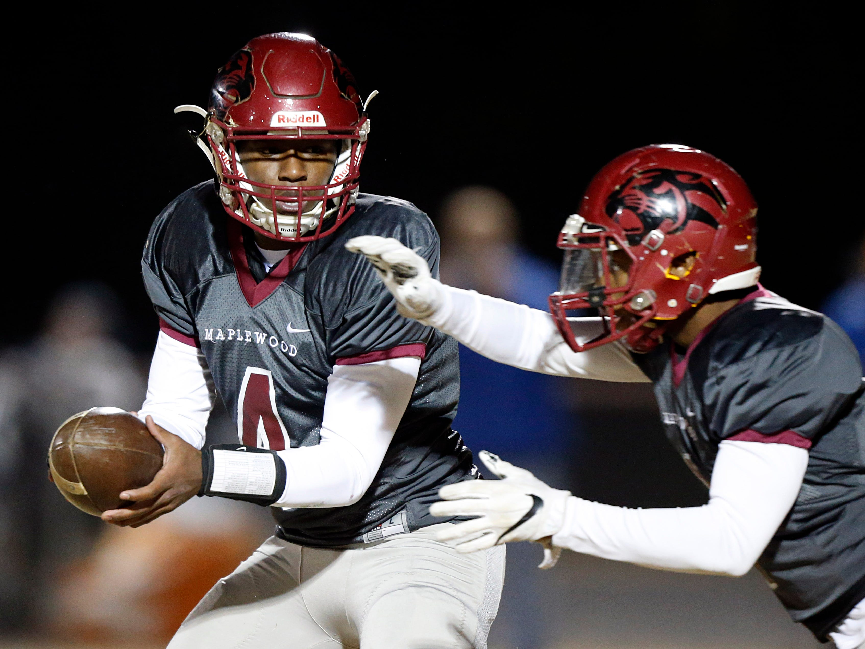 Maplewood's Bobo Hodges (4) turns to hand the ball off to David Southerland during their game against Greeneville Friday, Nov. 23, 2018, in Nashville, TN.