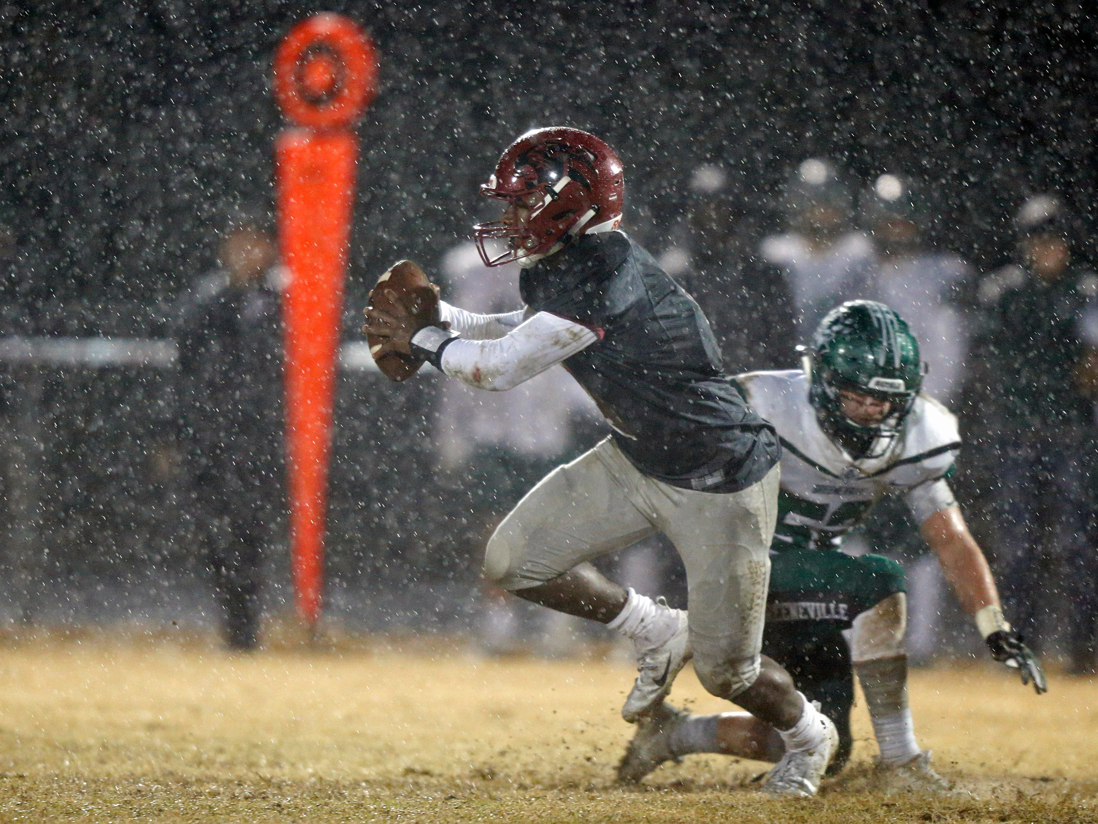 Maplewood's Bobo Hodges escapes from Greeneville's Trent Knight as the rain comes down during their game Friday, Nov. 23, 2018, in Nashville, TN.