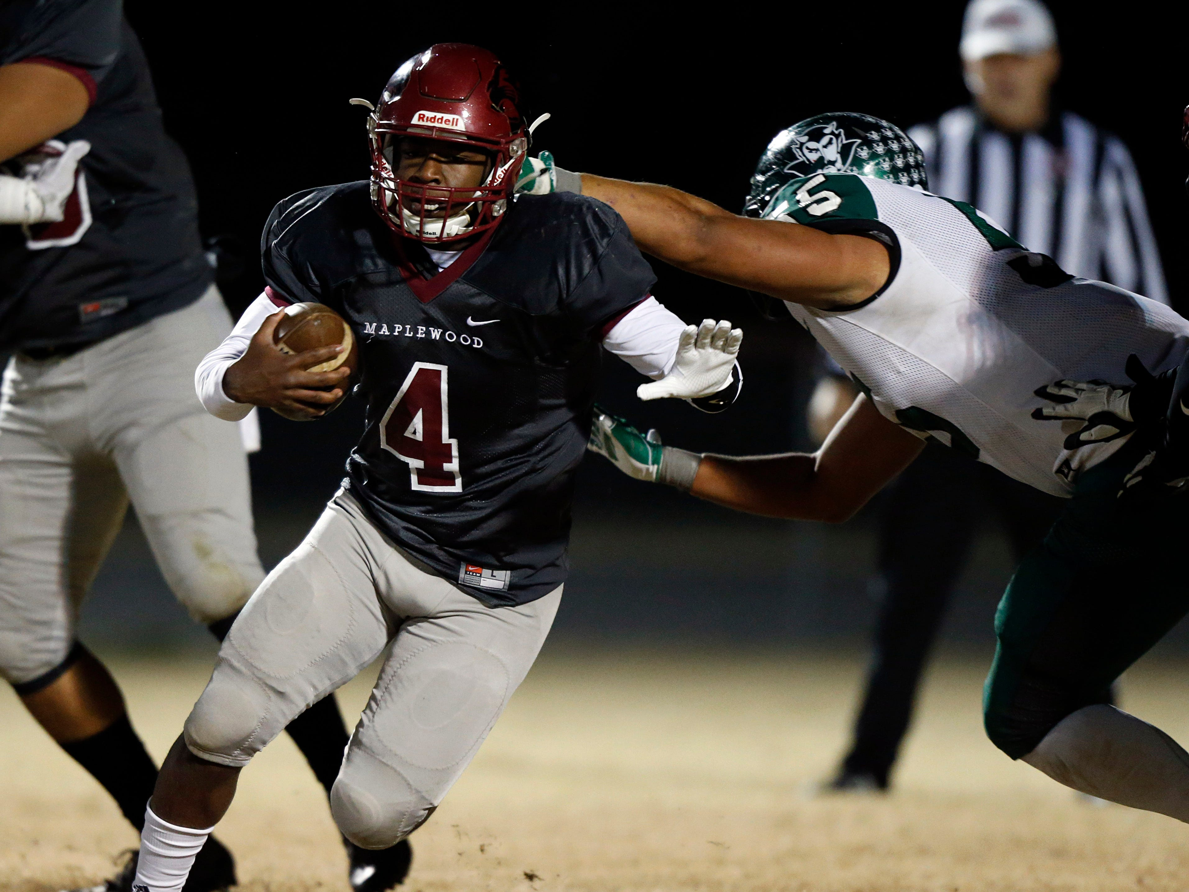 Maplewood's Bobo Hodges tries to escape from Greeneville's Logan Shipley during their game Friday, Nov. 23, 2018, in Nashville, TN.