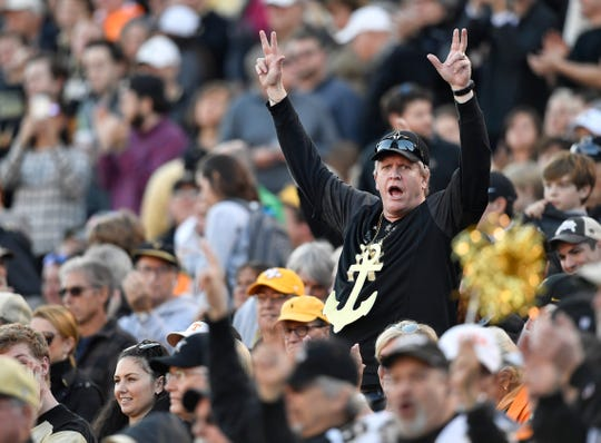 A Vandy fan cheers during the first half at Vanderbilt Stadium Saturday, Nov. 24, 2018, in Nashville, Tenn.