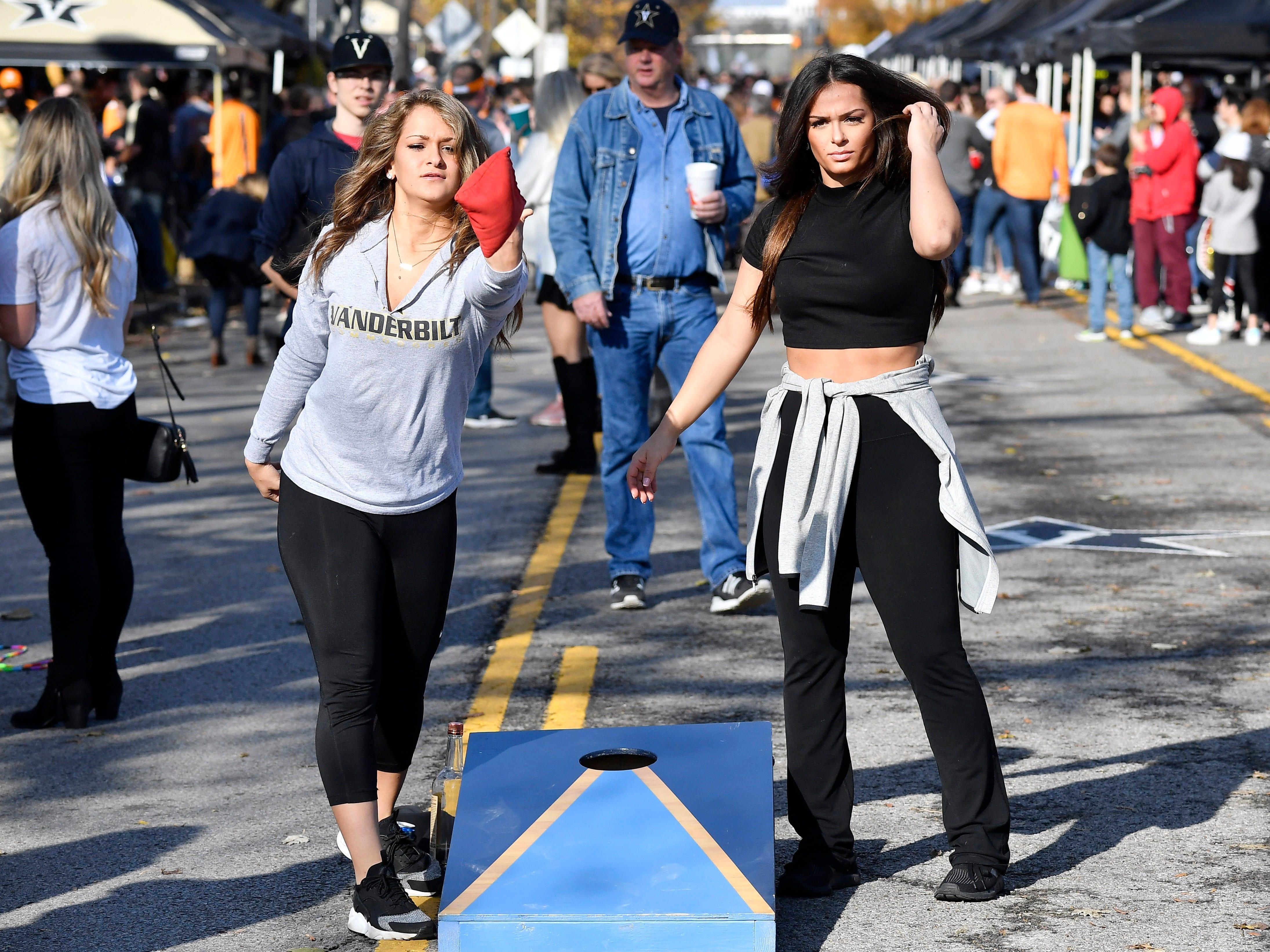 Sophia and Demi Patonis play corn hole before the game at Vanderbilt Stadium Saturday, Nov. 24, 2018, in Nashville, Tenn.
