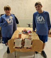Two brothers who are BGA Middle School students (Spencer Artrip, 5th grade, left, and Jackson Artrip, 7th grade) took their Halloween candy to their mom's office to raise money for the Ms. Cheap Penny Drive on Monday, Nov. 19, 2018.