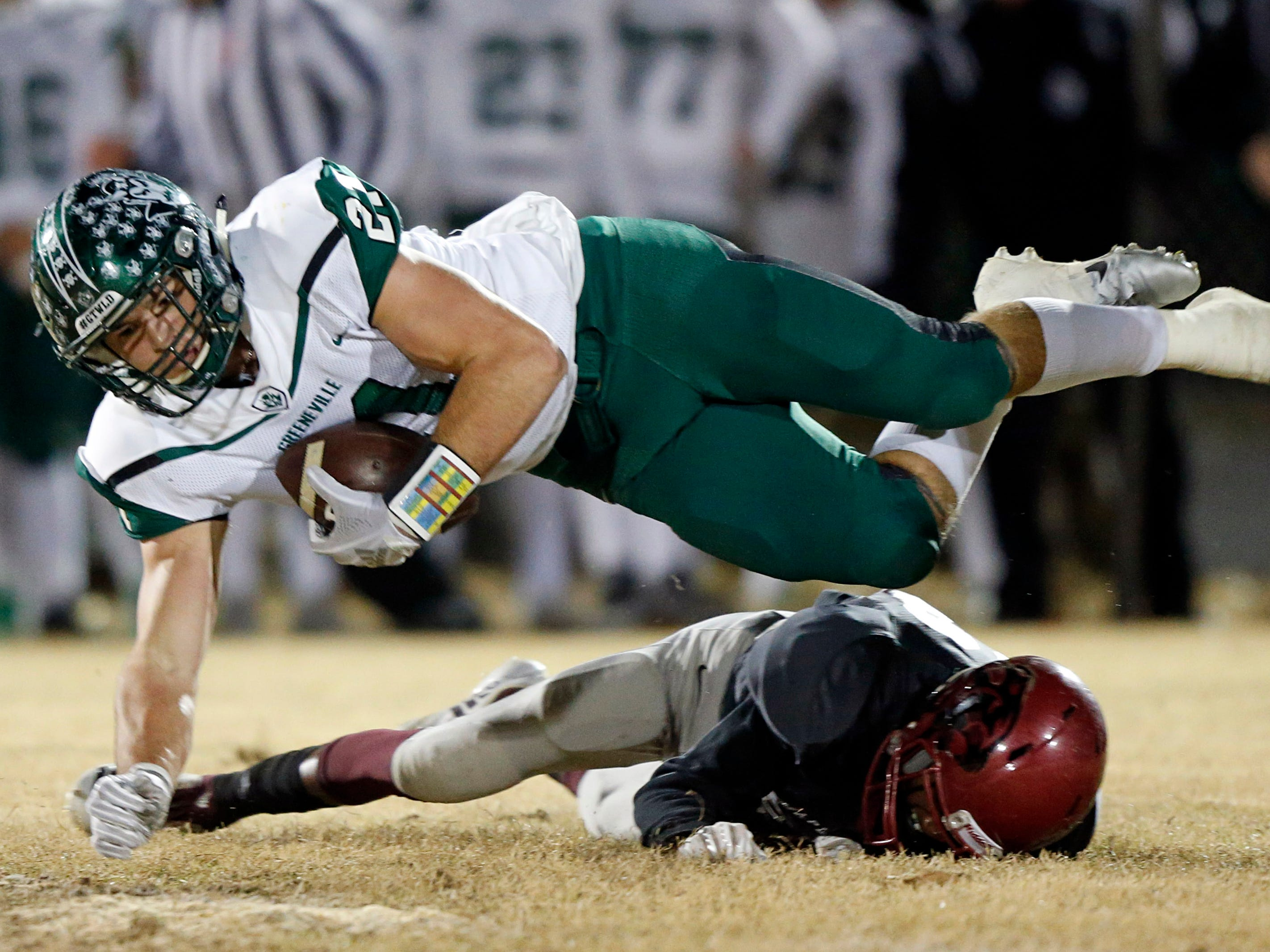 Greeneville's Cameron Hite is tackled by Maplewood's Ricky Harvell during their game Friday, Nov. 23, 2018, in Nashville, TN.