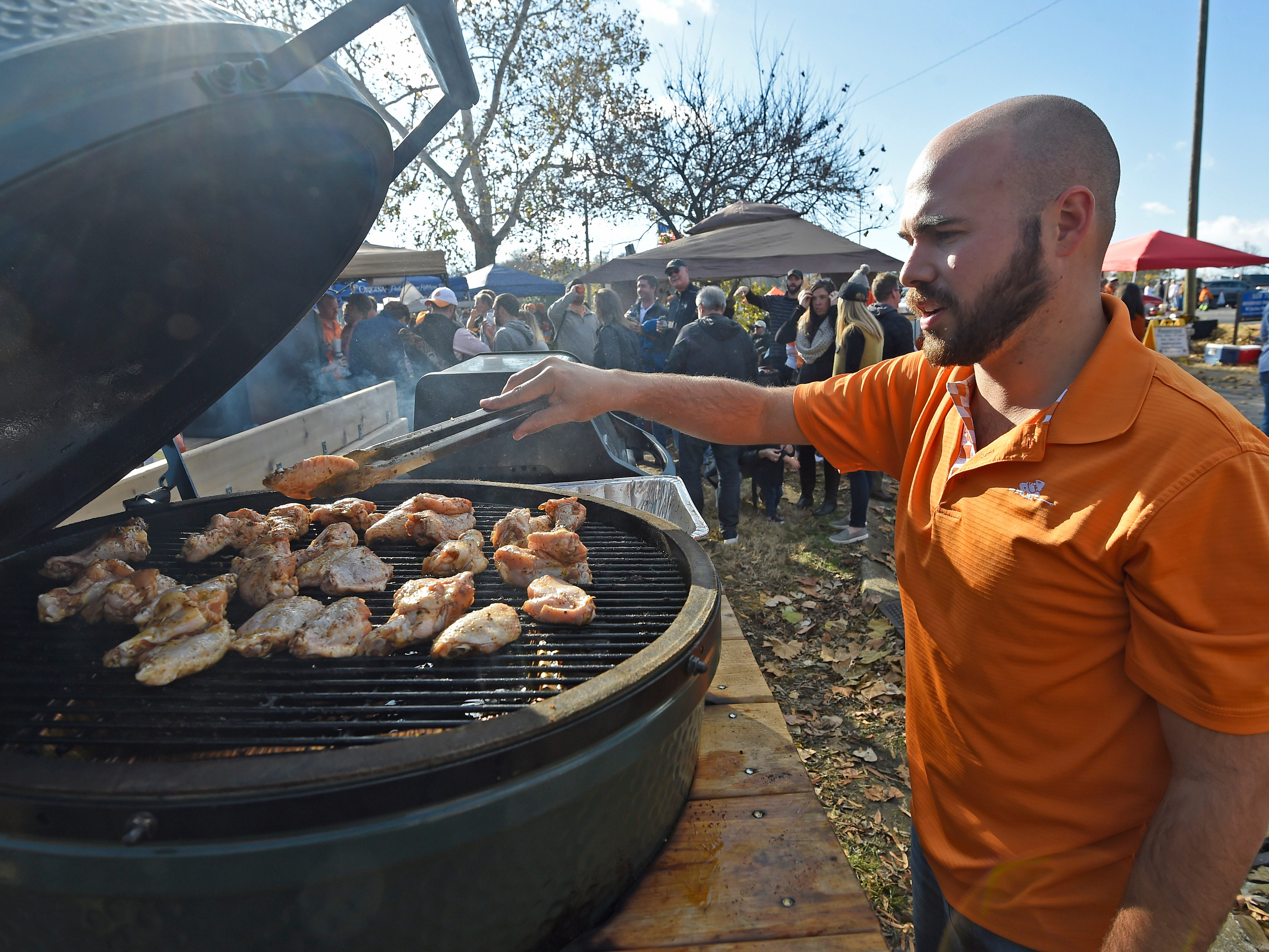 Vols fan Chris Walsh of Nashville grills before the game at Vanderbilt Stadium Saturday, Nov. 24, 2018, in Nashville, Tenn.