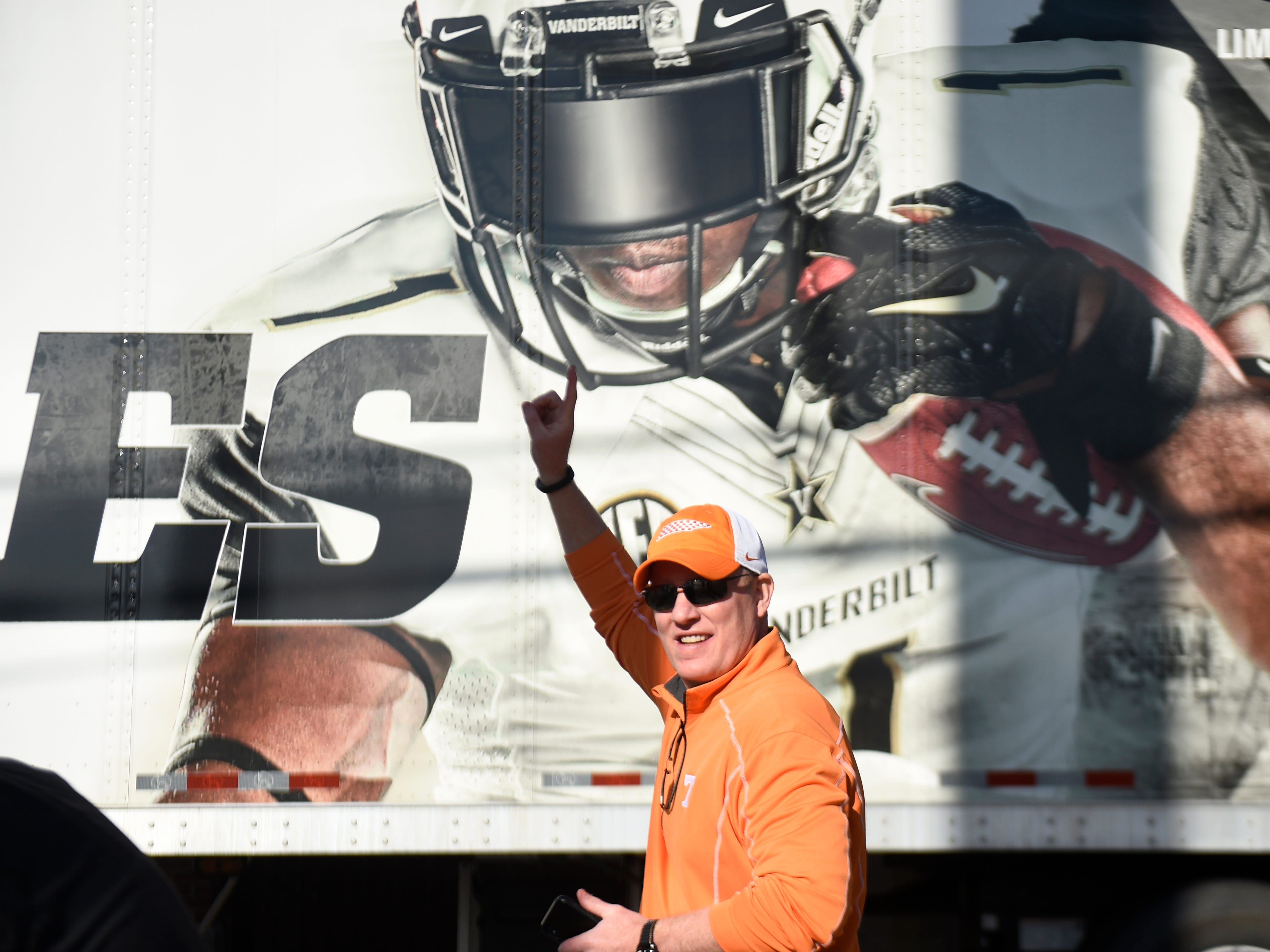 A Tennessee fan walks past a Vandy sign before the game at Vanderbilt Stadium Saturday, Nov. 24, 2018, in Nashville, Tenn.