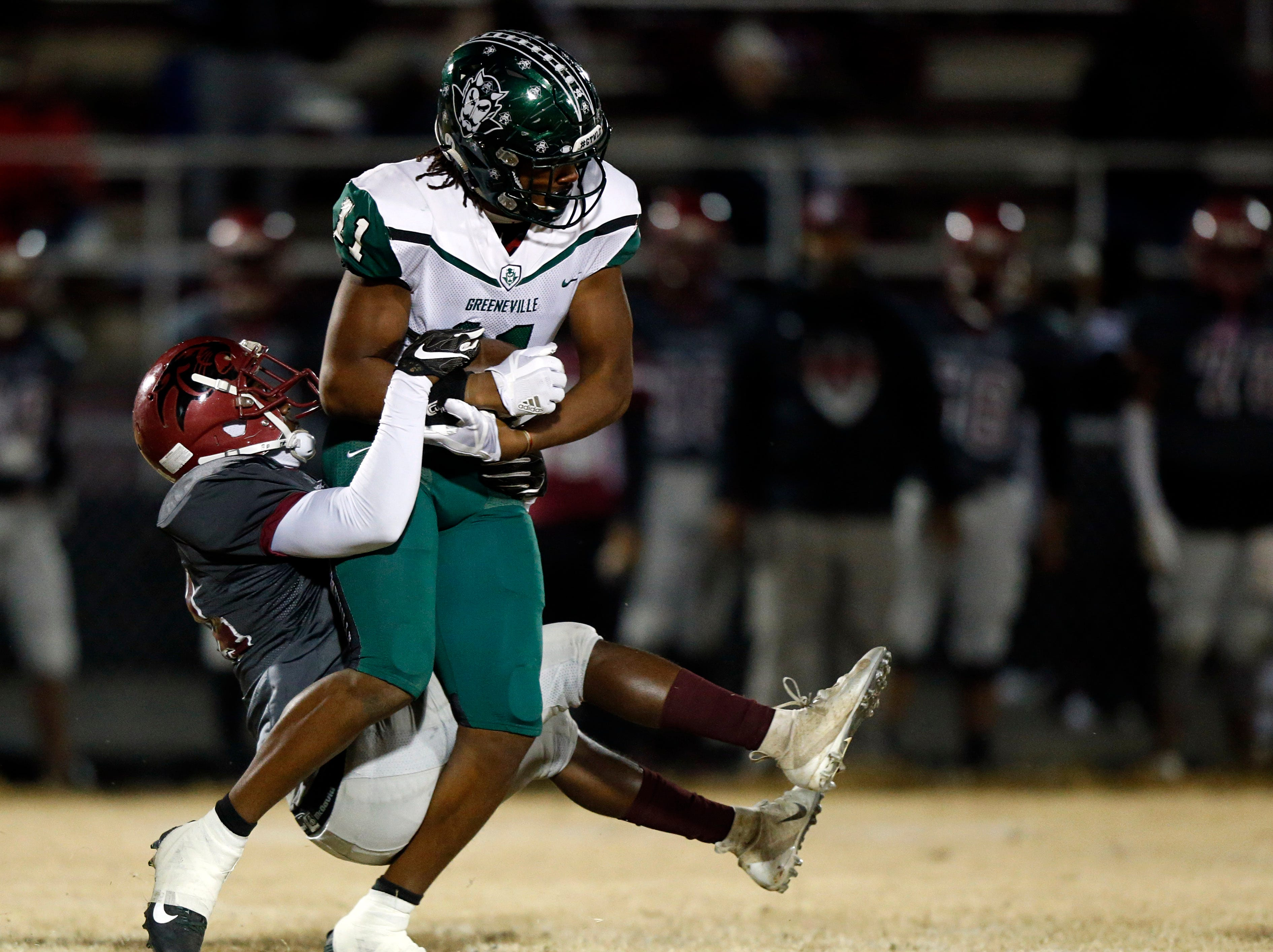 Greeneville's Dorien Goddard is tackled by Maplewood's Eric Johns Jr. during their game Friday, Nov. 23, 2018, in Nashville, TN.