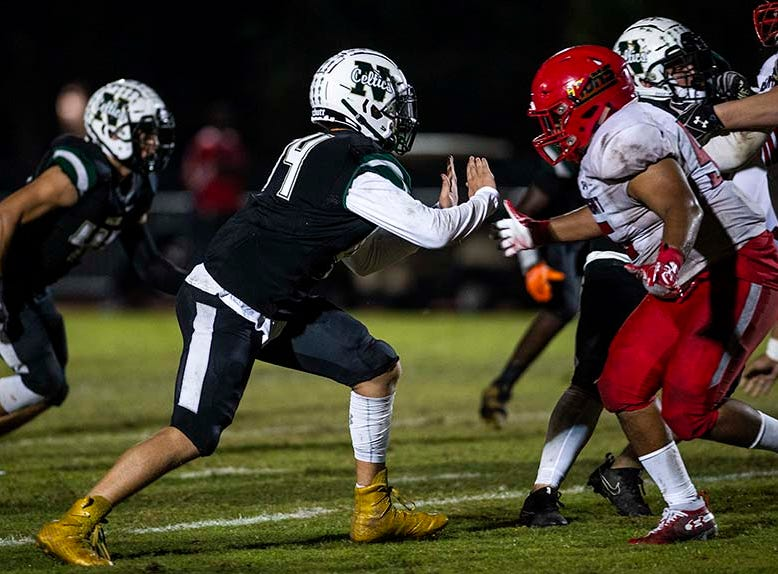 St. John Neumann's Tyler Pasko plays defense during the class 2A regional final against Hialeah-Champagnat in Naples, Fla. on Friday, November 23, 2018.