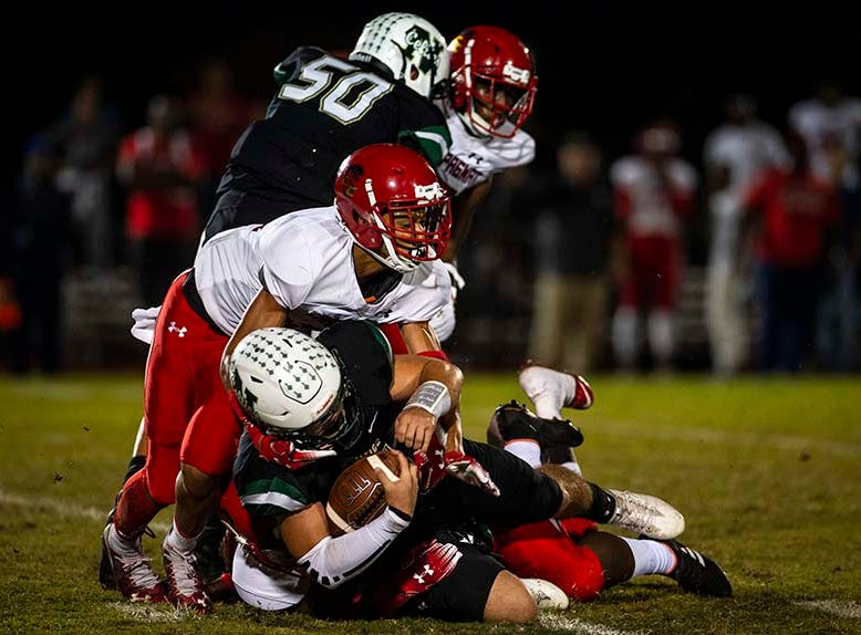 St. John Neumann's Jensen Jones gets brought down during the class 2A regional final against Hialeah-Champagnat in Naples, Fla. on Friday, November 23, 2018.