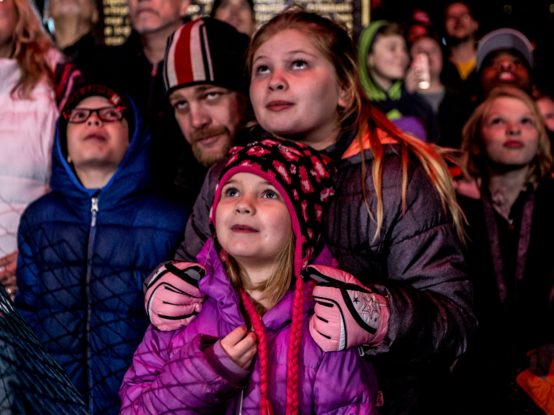 JD Robinson watches with his children Hailey, 11, Zoey, 6, and Jayce, 10, as the courthouse lights were turned on Friday evening.