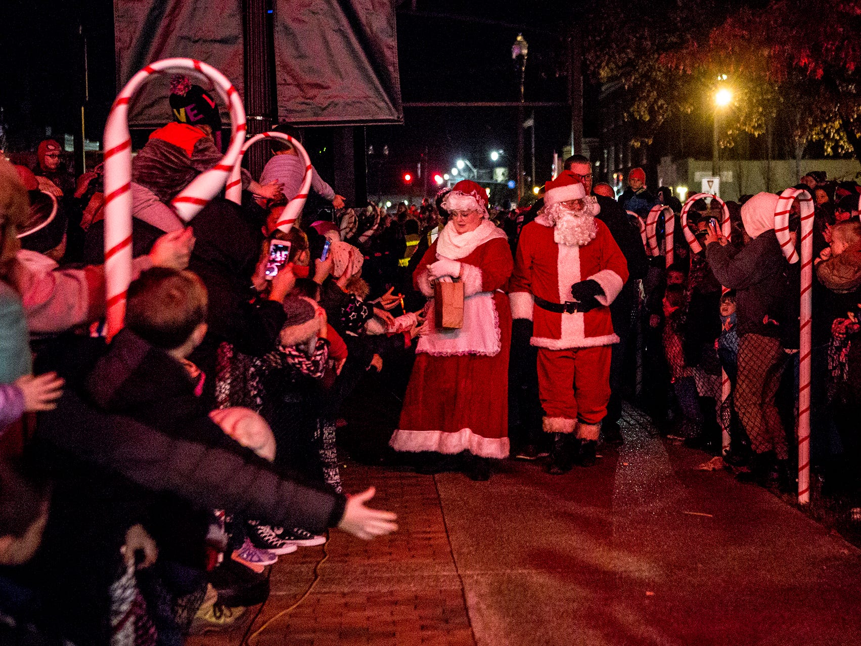 Crowds gathered around the Licking County Courthouse Friday evening to greet Santa and Mrs. Claus, and watch as the courthouse lights came on.