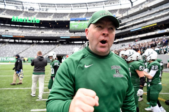 Ramapo head coach Drew Gibbs celebrates on the sideline as his team defeats Summit 42-22 in the North Group 3 Bowl Game on Saturday, Nov. 24, 2018, in East Rutherford.