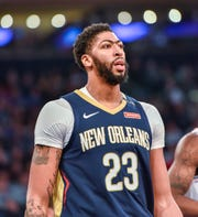 New Orleans Pelicans forward Anthony Davis (23) reacts after scoring in the first quarter of an NBA basketball game against the New York Knicks, Friday, Nov. 23, 2018, in New York.