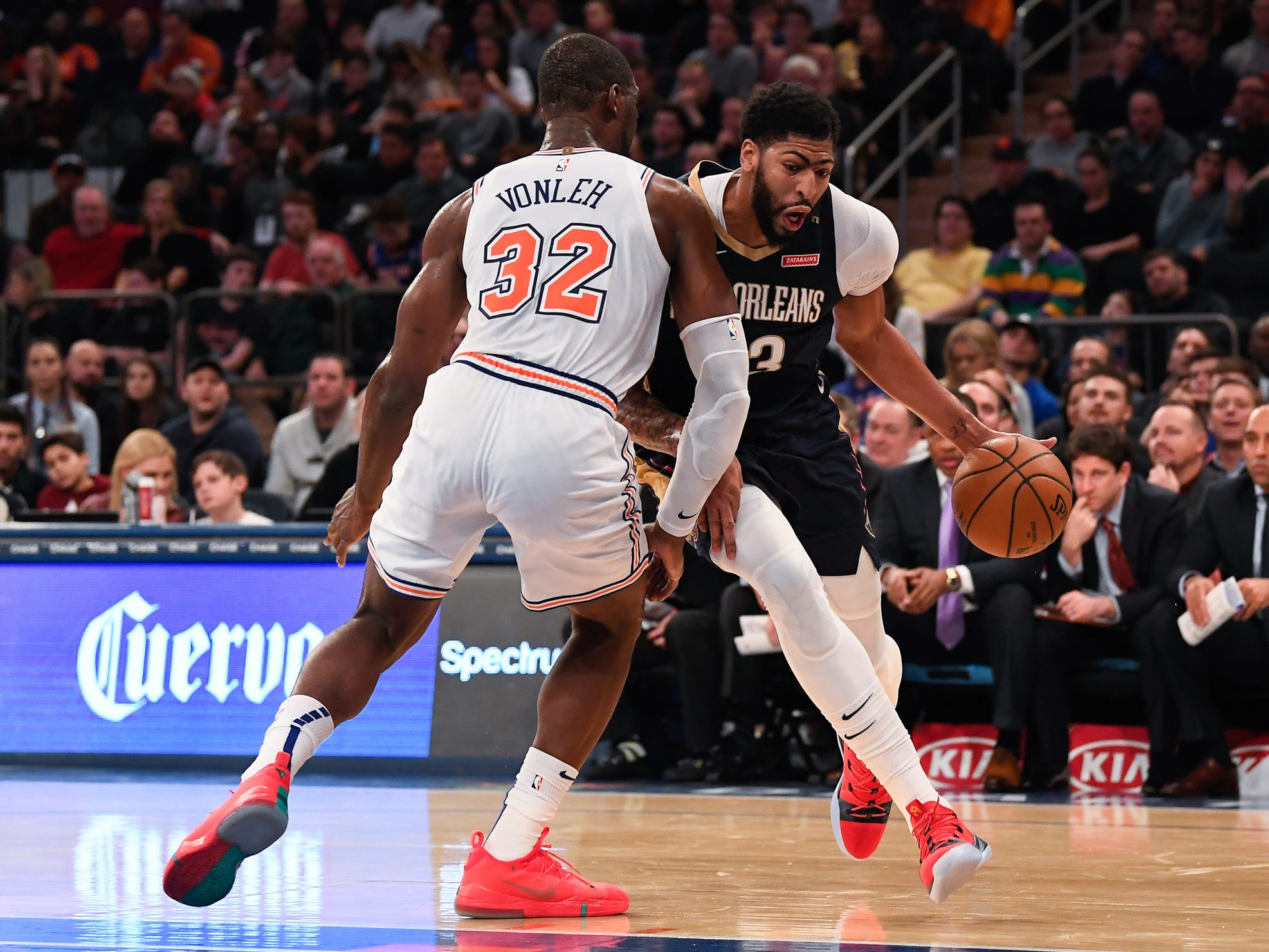 Nov 23, 2018; New York, NY, USA; New Orleans Pelicans forward Anthony Davis (23) dribbles the ball past New York Knicks forward Noah Vonleh (32) in the second quarter at Madison Square Garden.