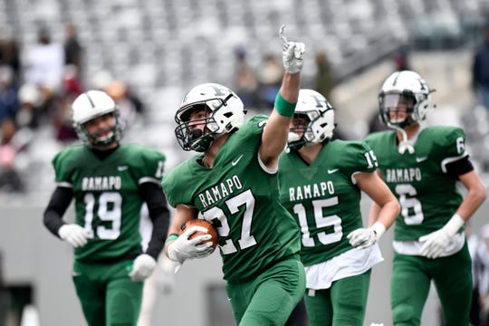 Ramapo's Max Baker (27) celebrates his touchdown in the second half. Ramapo defeats Summit 42-22 in the North Group 3 Bowl Game on Saturday, Nov. 24, 2018, in East Rutherford.