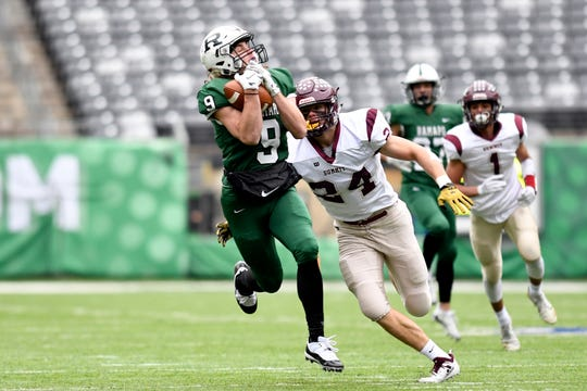 Ramapo's Isaiah Savitt (9) makes a catch over Summit defender Jackson Tyler (24) in the first half. Ramapo faces Summit in the North Group 3 Bowl Game on Saturday, Nov. 24, 2018, in East Rutherford.
