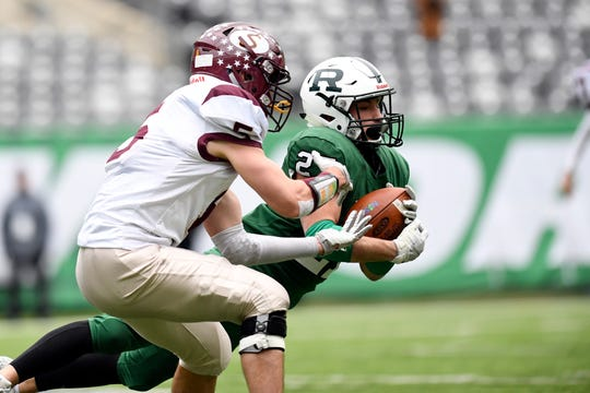 Ramapo's Max Baker, right, intercepts a pass intended for Summit's Jack Kelly in the first half. Ramapo faces Summit in the North Group 3 Bowl Game on Saturday, Nov. 24, 2018, in East Rutherford.