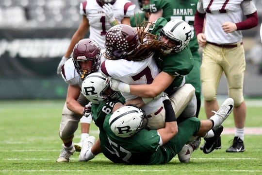 Ramapo defense stops Summit's Max Jackson (7) short of a first down. Ramapo defeats Summit 42-22 in the North Group 3 Bowl Game on Saturday, Nov. 24, 2018, in East Rutherford.