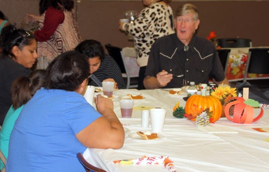 Joe Karas enjoyed a delicious Thanksgiving dinner and good conversation at his table on Thursday at the First United Methodist Church.
