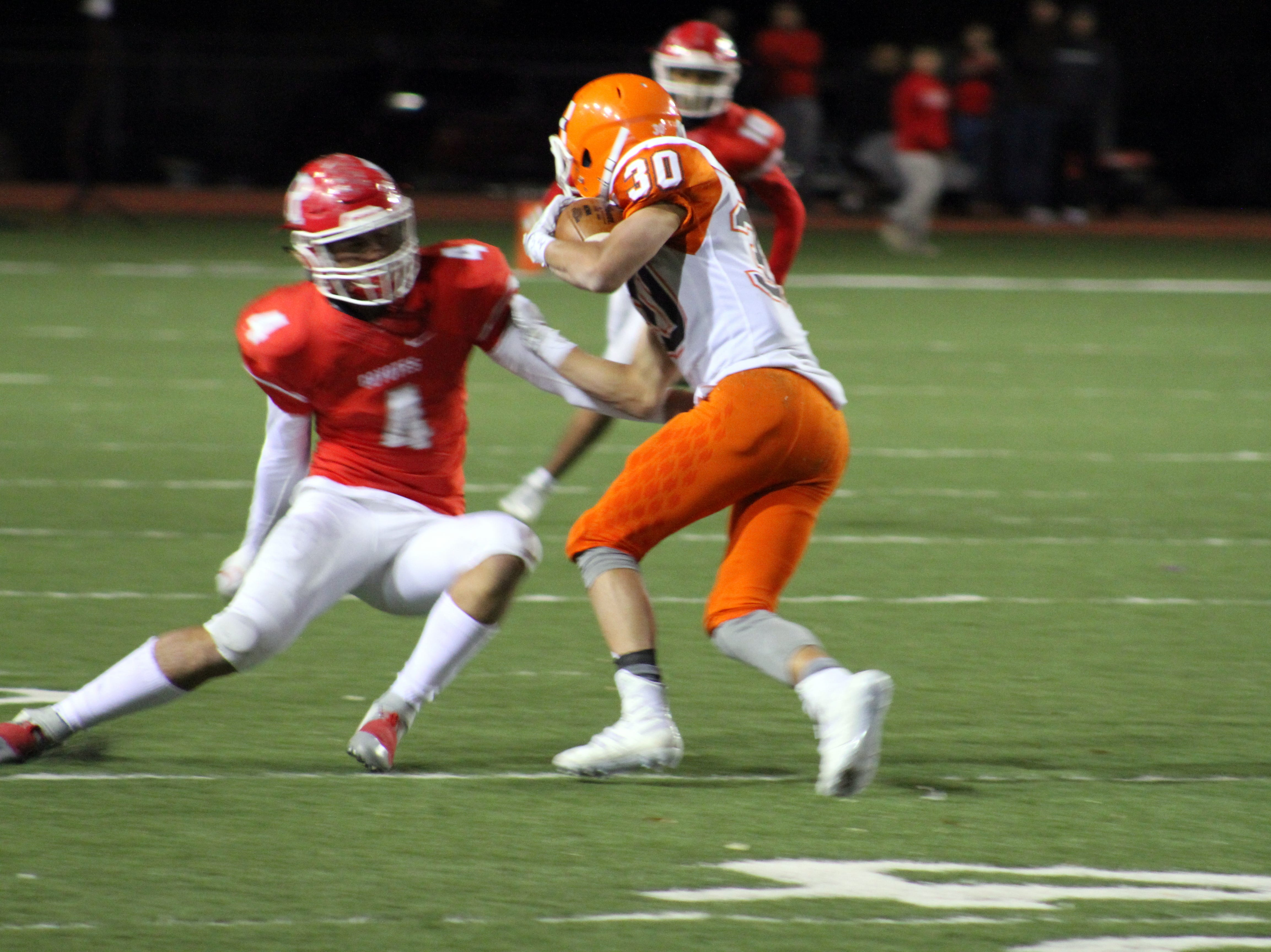 Artesia's Jagger Donaghe jukes Roswell's Dylan Tucker during Friday's Class 5A semifinal game. Donaghe scored four total touchdowns in the game.