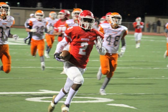 Roswell's Jasia Reese speeds by Artesia's defense on his way to score one of his two toucdowns during Friday's Class 5A semifinal game. He finished with 6 catches going for 103 yards