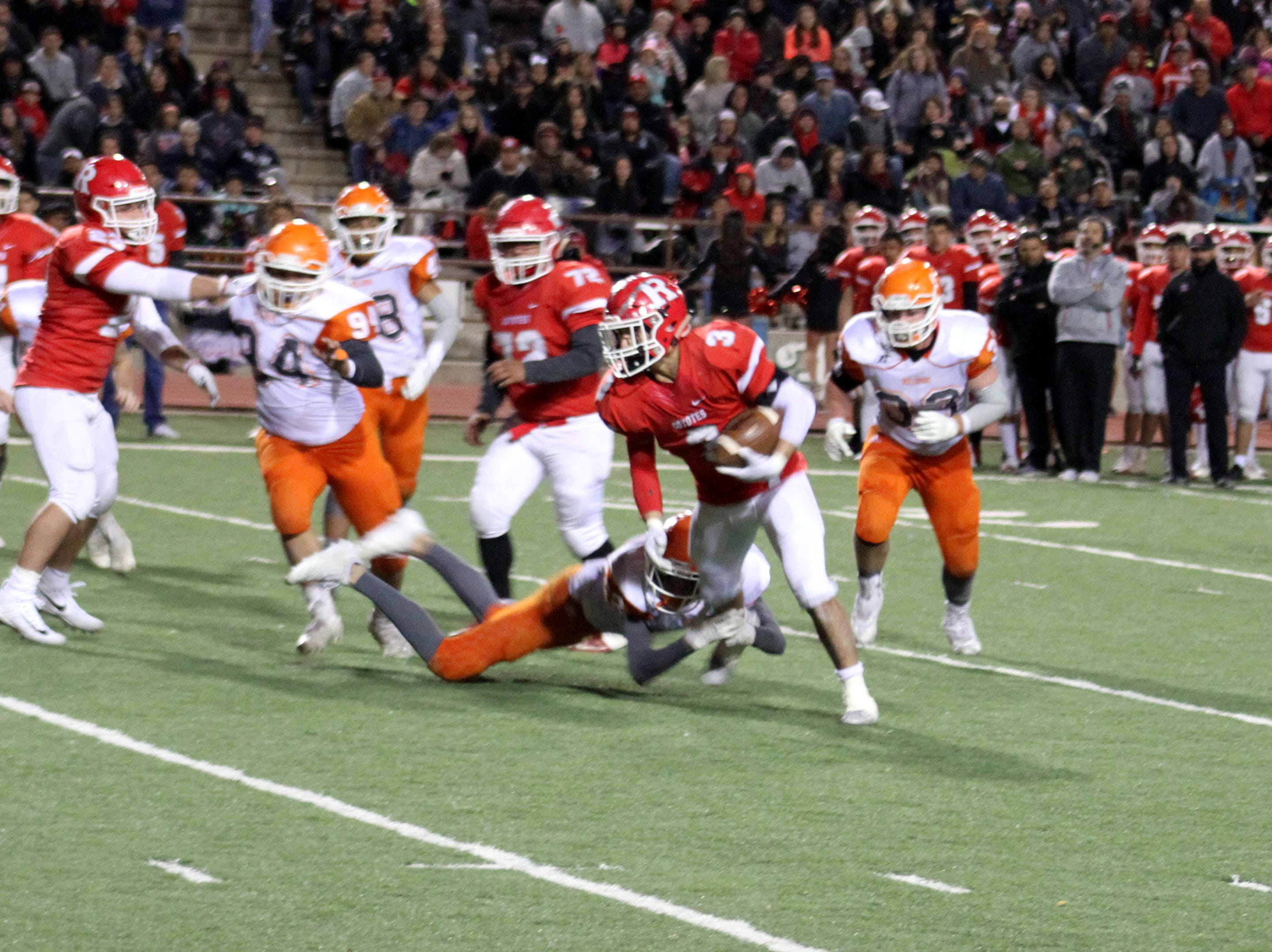 Roswell's Justin Carrasco escapes an Artesia defender during Friday's Class 5A semifinal game. Carrasco finished with one reception for 43 yards and 23 rushes for 140 yards and two touchdowns.