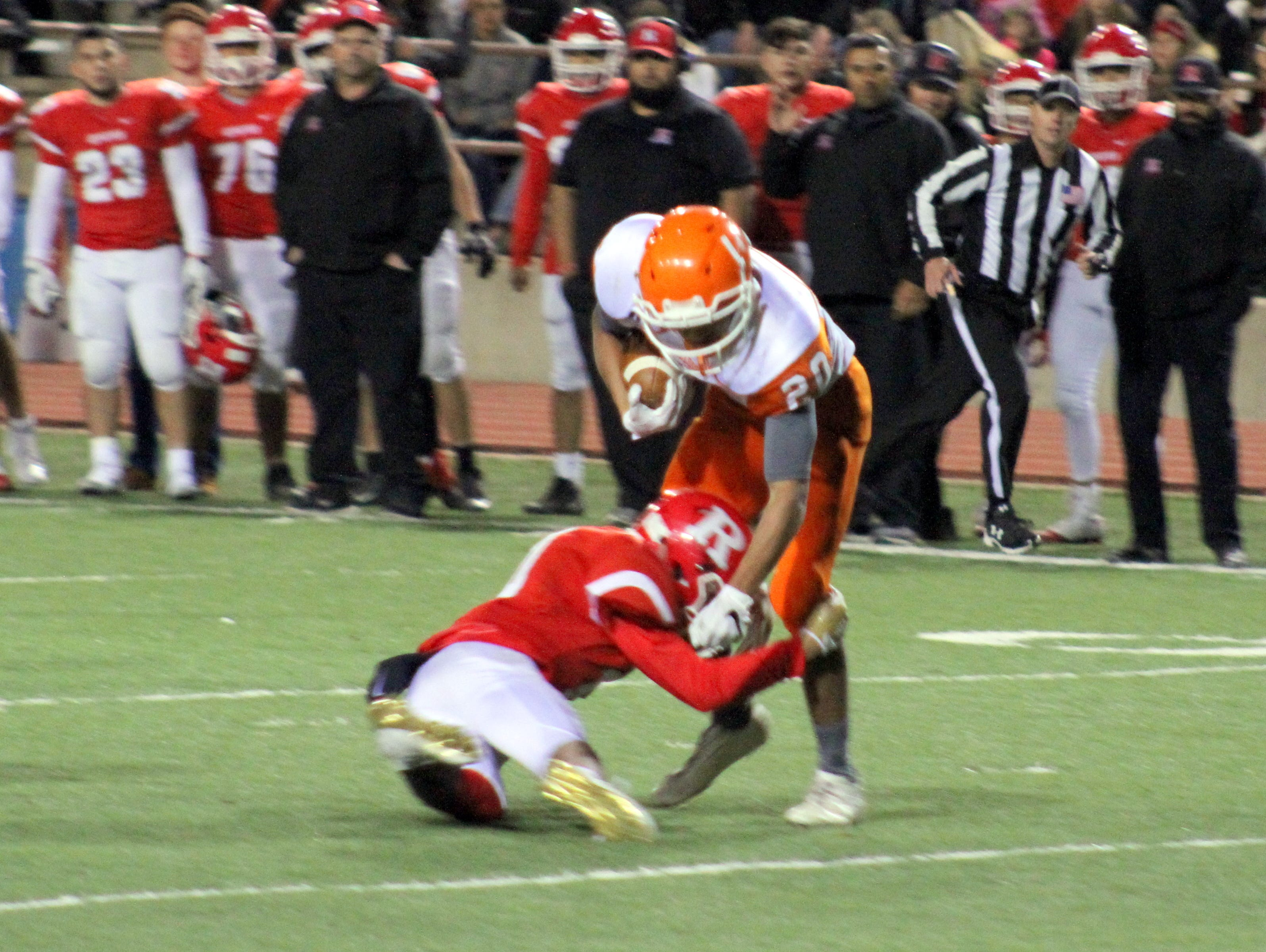 Artesia's Alex Fernandez escapes a Roswell tackler during Friday's Class 5A semifinal game. Fernandez finished with seven catches, 43 yards and one touchdown.