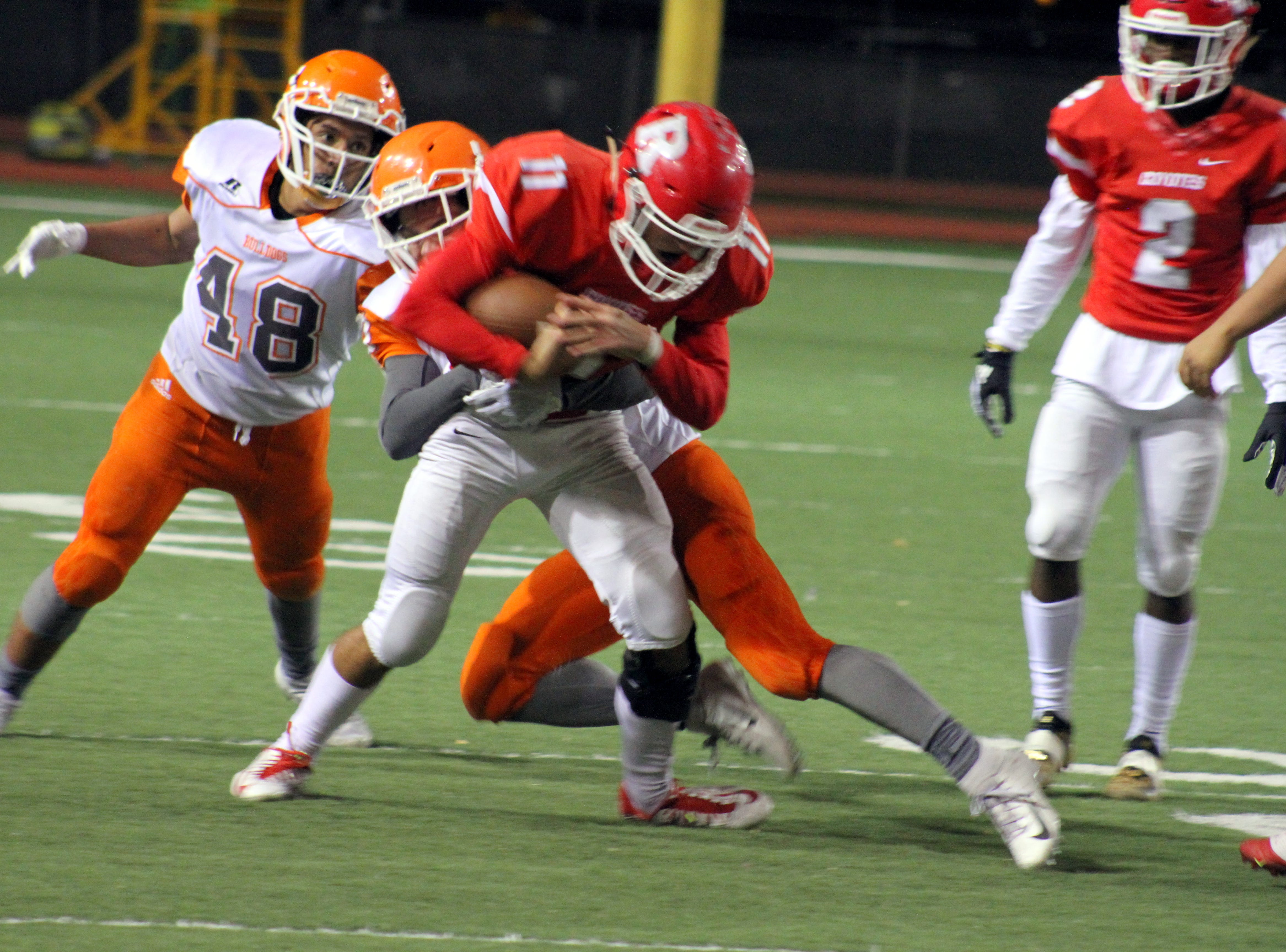 Roswell quarterback Ethan Valenzuela is taken down by Artesia's Ty Johnson during Friday's Class 5A semifinal game.