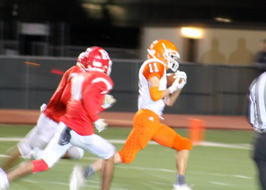 Artesia's Erik Cueto hauls in a long catch by quarterback Trent Taylor during Friday's Class 5A semifinal game. Cueto finished with 94 receiving yards.