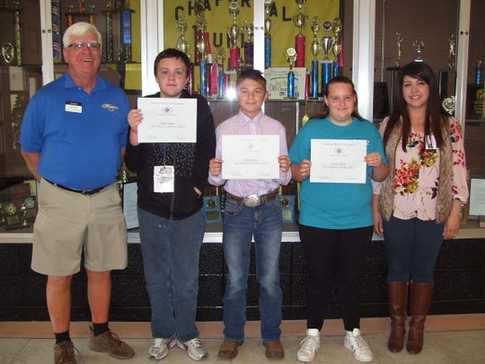 Chaparral Middle School pictured left to right: Kiwanis Club member Ned Kline with Chaparral Middle students Ethan Wood, Tyler Lucero, Jessica Collins and Chaparral Principal Cynthia Bond.