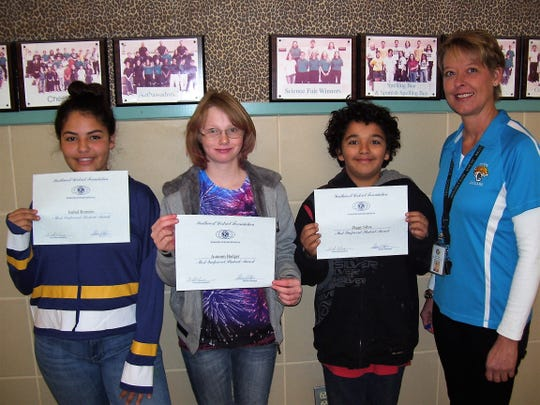 Mountain View Middle School pictured left to right: Mountain View students Isabel Romero, Autumn Badger and Ziggy Silva with Mountain View Assistant Principal Alicia Edgin.