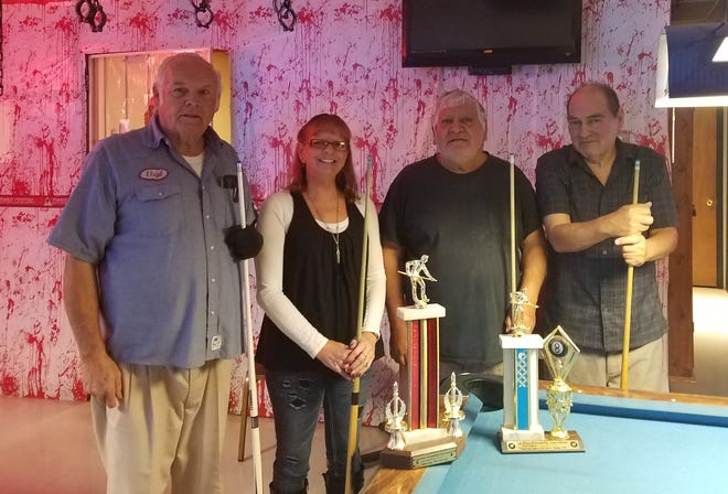 The Friendship Pool winners for October are from left to right: Second place Elks members Lloyd Miller and Terri Jo Blunt; and first place VFW members Joe Lujan and Danny Lujan.