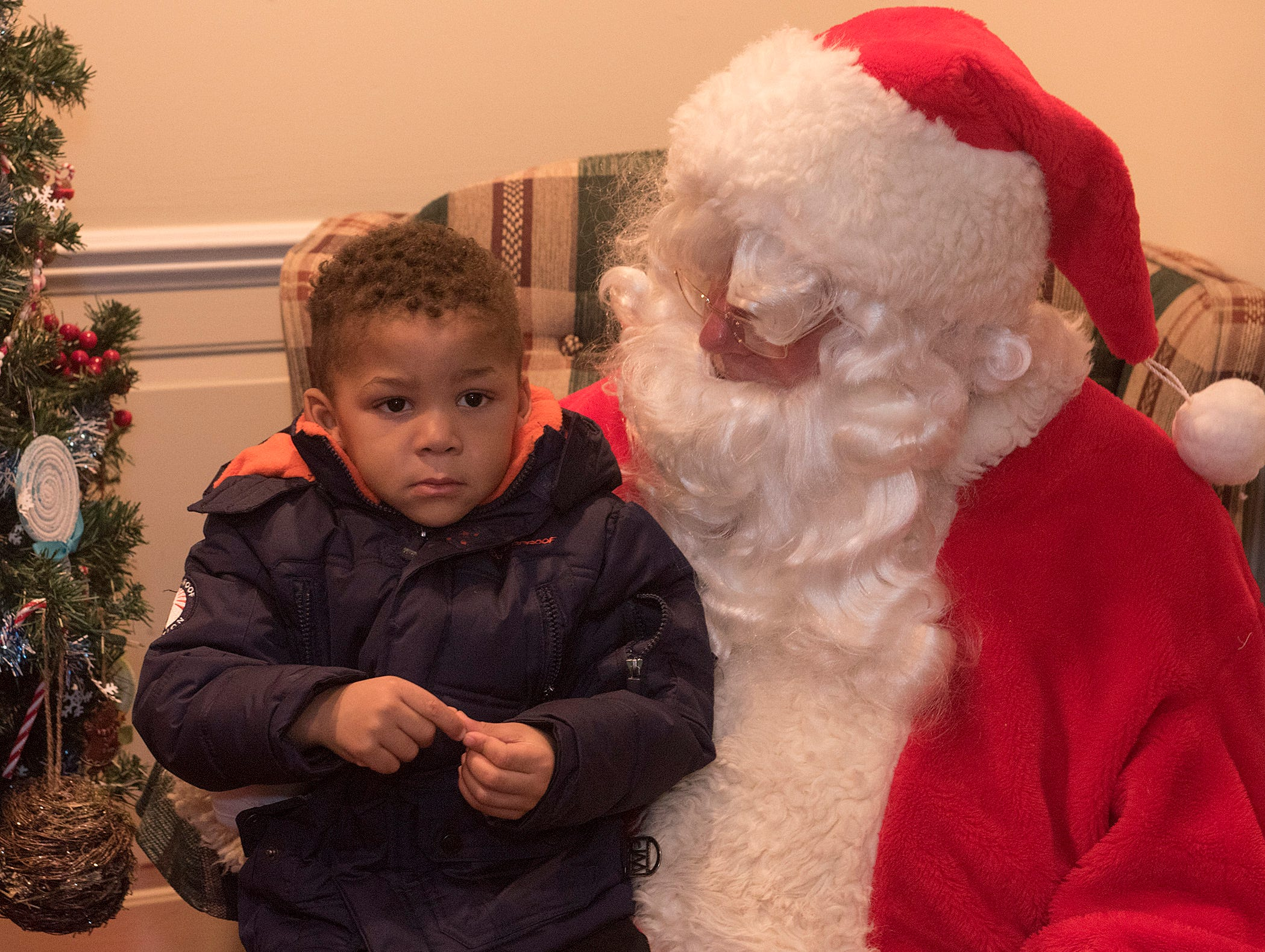 Kayson Woods doesn't look too sure about the big guy in the red suit.