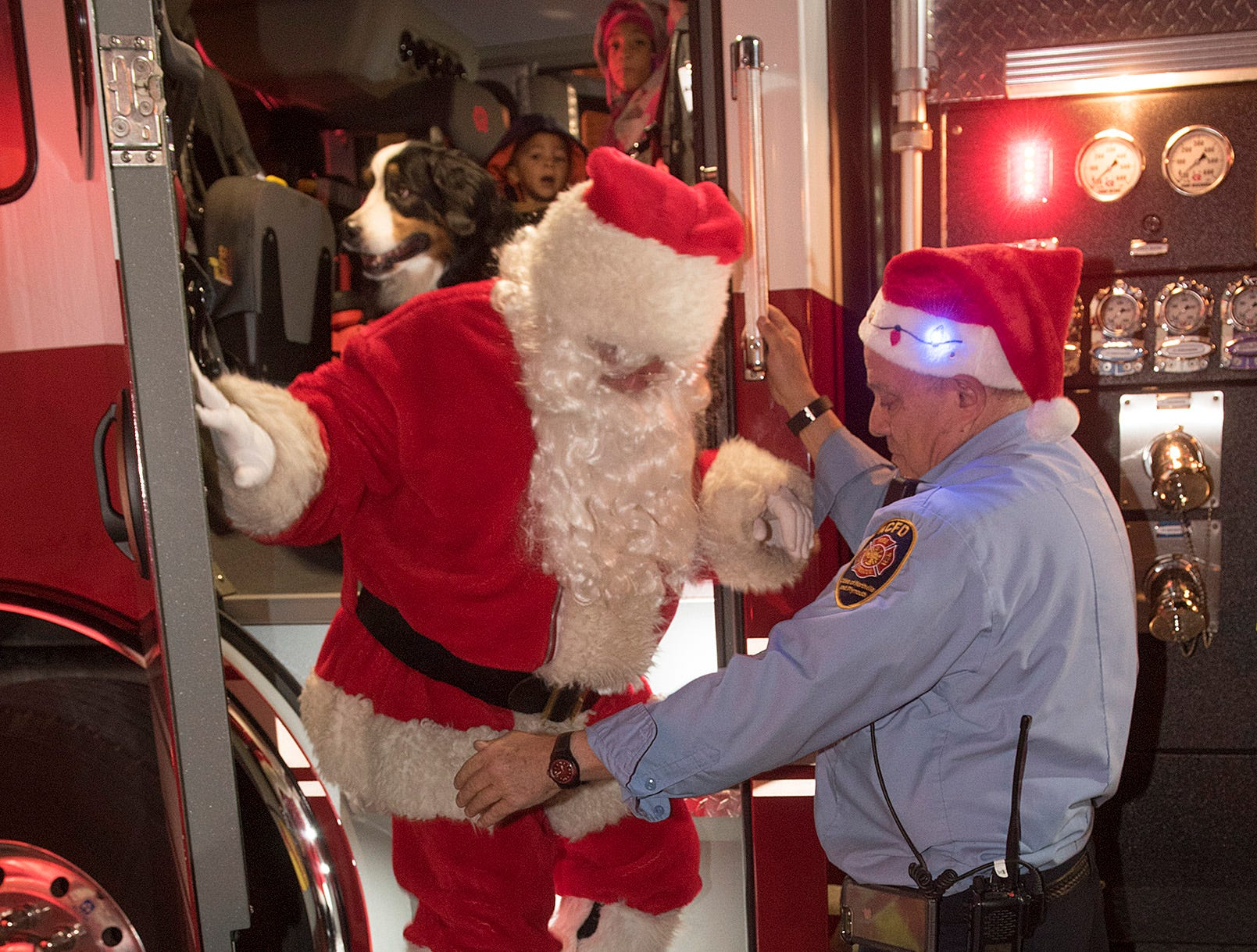 Santa Claus had to ditch the sleigh and reindeer because there was no snow. That jolly old elf, Captain Jim Davison, was happy to give Santa a lift.