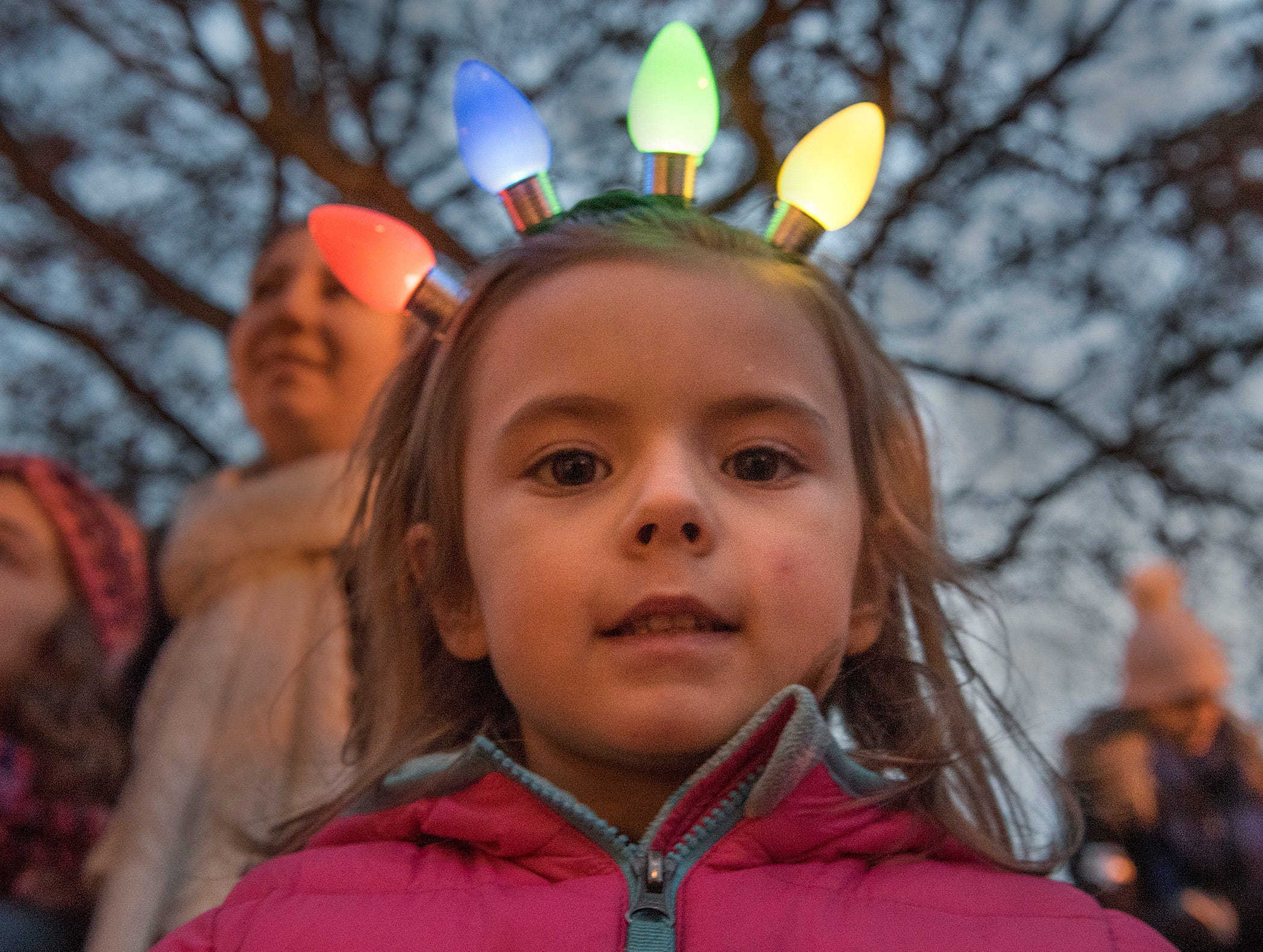 Aubrey Meier, 4 years old, of Canton, waits for Santa Claus to arrive at Kellogg Park.