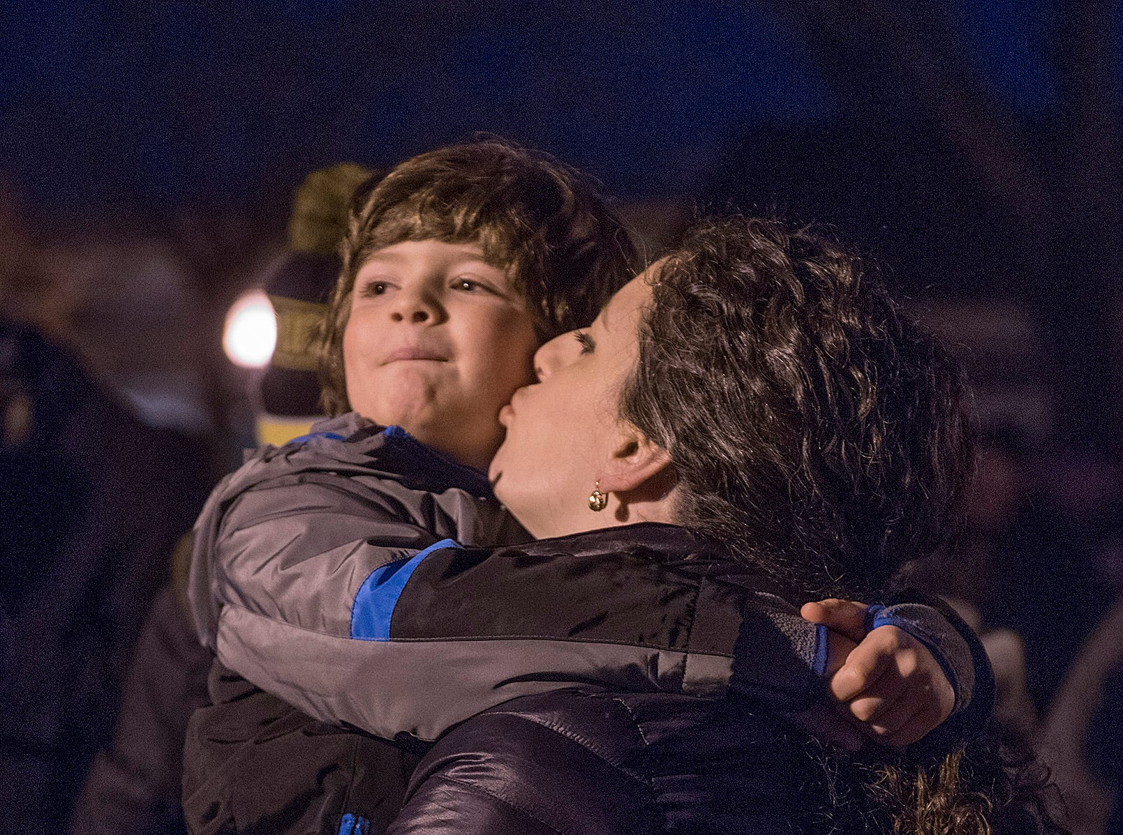 Marta Fabiilli gives son Francesco, 5 years old, a kiss as they await Santa's arrival.