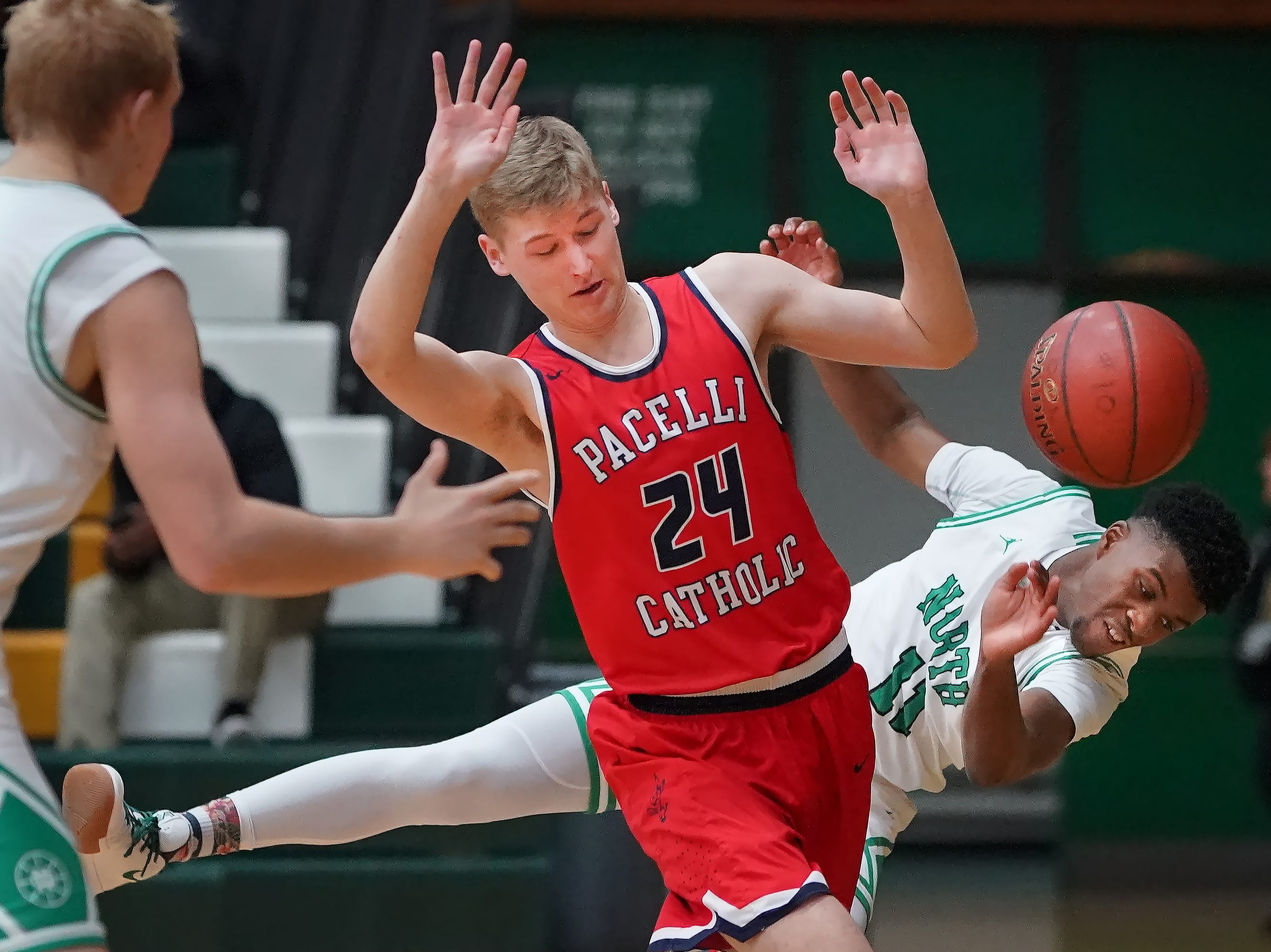 Abe Schiek (11) of Oshkosh North tries to keep the ball in bounds in the first half. The Oshkosh North Spartans hosted the Stevens Point Pacelli Catholic Cardinals in the Friday night game of the Fox River Brewing Thanksgiving Classic Tournament.