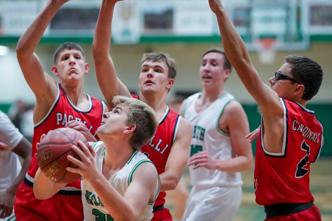 Scott Swanlund (35) of Oshkosh North tries to take a shot. The Oshkosh North Spartans hosted the Stevens Point Pacelli Catholic Cardinals in the Friday night game of the Fox River Brewing Thanksgiving Classic Tournament.
