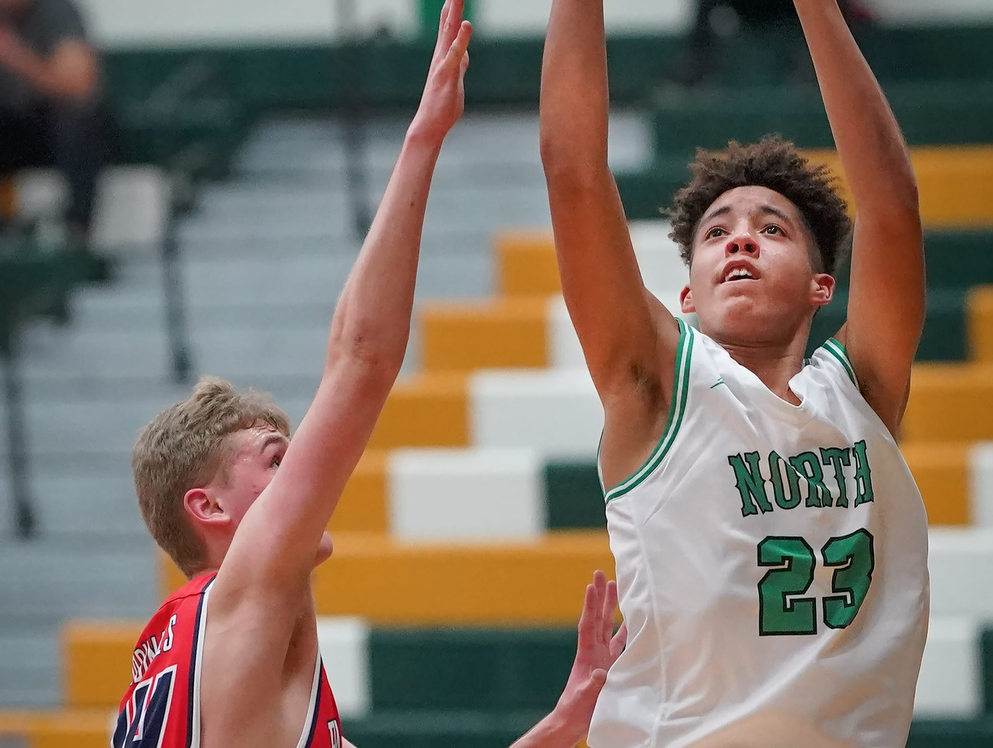 Jalen Keago (23) of Oshkosh North goes up for a shot. The Oshkosh North Spartans hosted the Stevens Point Pacelli Catholic Cardinals in the Friday night game of the Fox River Brewing Thanksgiving Classic Tournament.