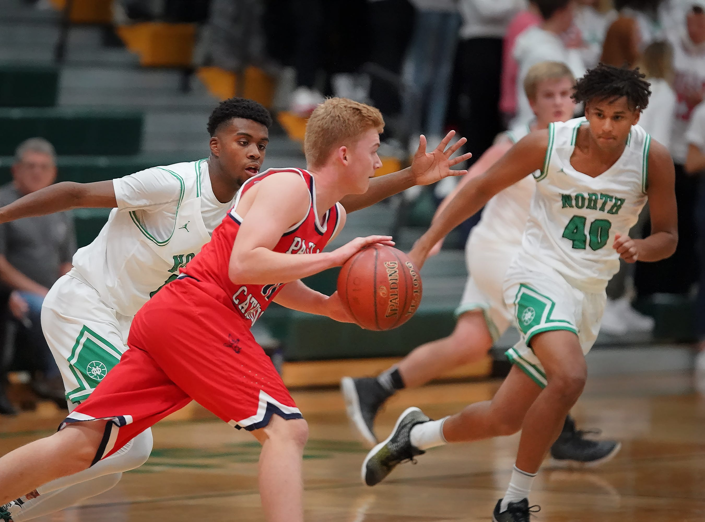 Nate Helms (10) of Pacelli moves the ball down court. The Oshkosh North Spartans hosted the Stevens Point Pacelli Catholic Cardinals in the Friday night game of the Fox River Brewing Thanksgiving Classic Tournament.