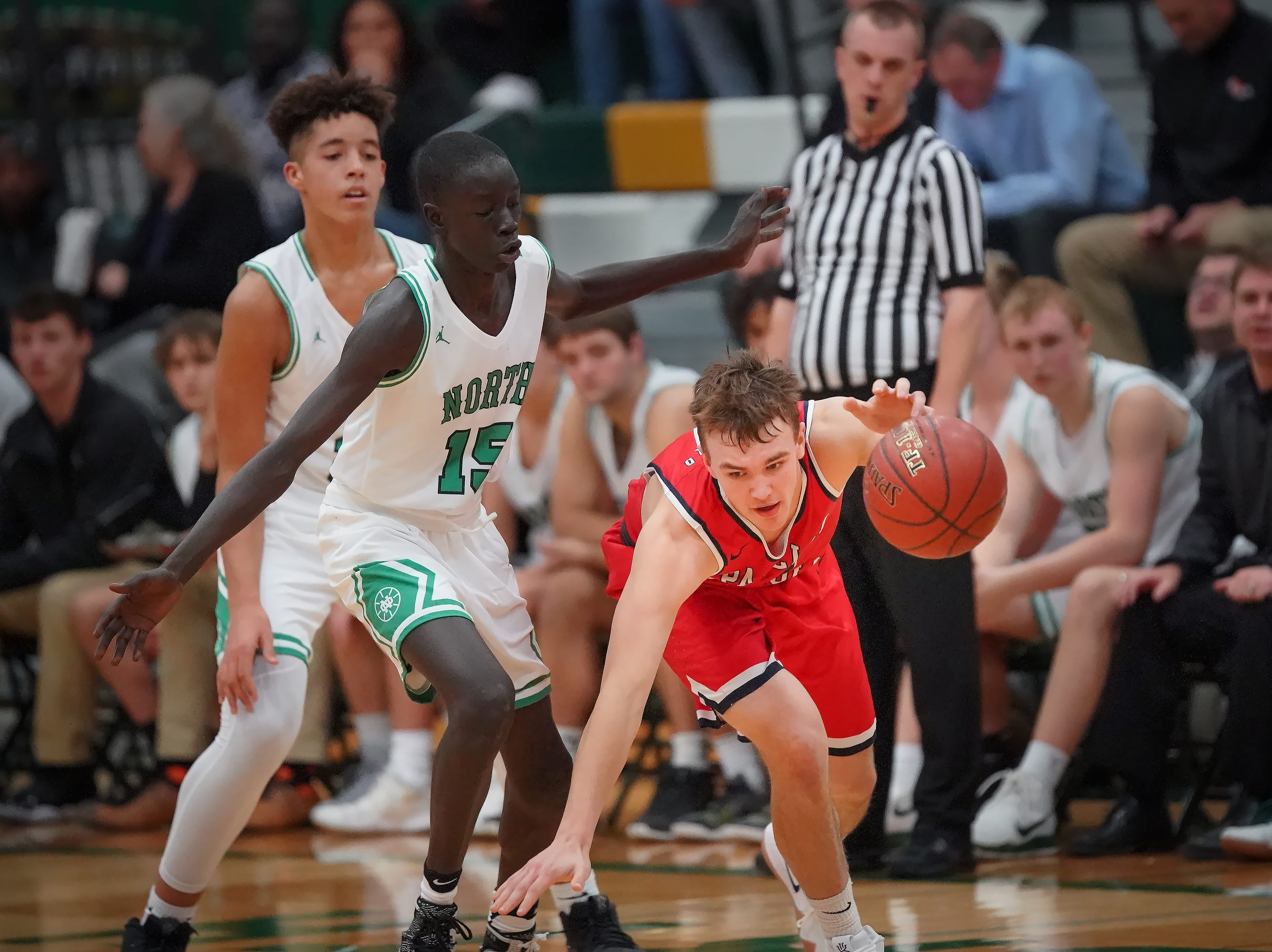 Jonah Peplinski (11) of Pacelli chases a loose ball. The Oshkosh North Spartans hosted the Stevens Point Pacelli Catholic Cardinals in the Friday night game of the Fox River Brewing Thanksgiving Classic Tournament.