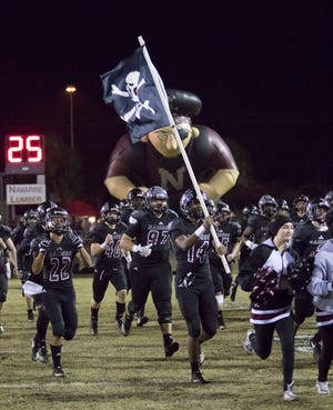 The Raiders take the field before the Crestview vs Navarre playoff football game at Navarre High School on Friday, November 23, 2018.