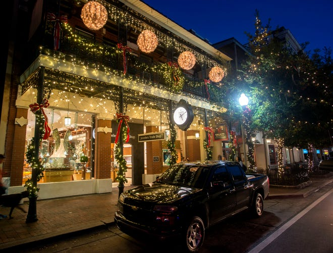 Christmas lights light up downtown Pensacola Saturday, November 24, 2018.