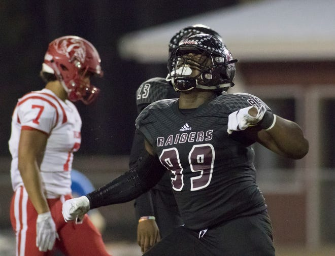 Navarre High's Jordan Jefferson reacts after making a stop against Crestview last Friday in the Class 6A quarterfinals in Navarre. With Navarre's loss, it makes six years since a Pensacola-area team played for a football state title.