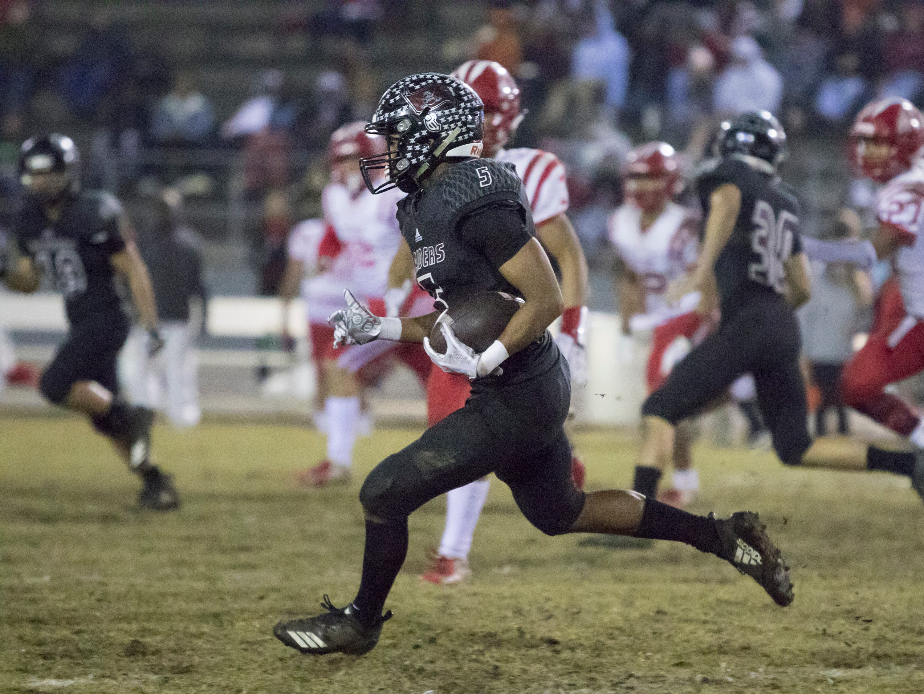 Dante Wright (5) carries the ball during the Crestview vs Navarre playoff football game at Navarre High School on Friday, November 23, 2018.