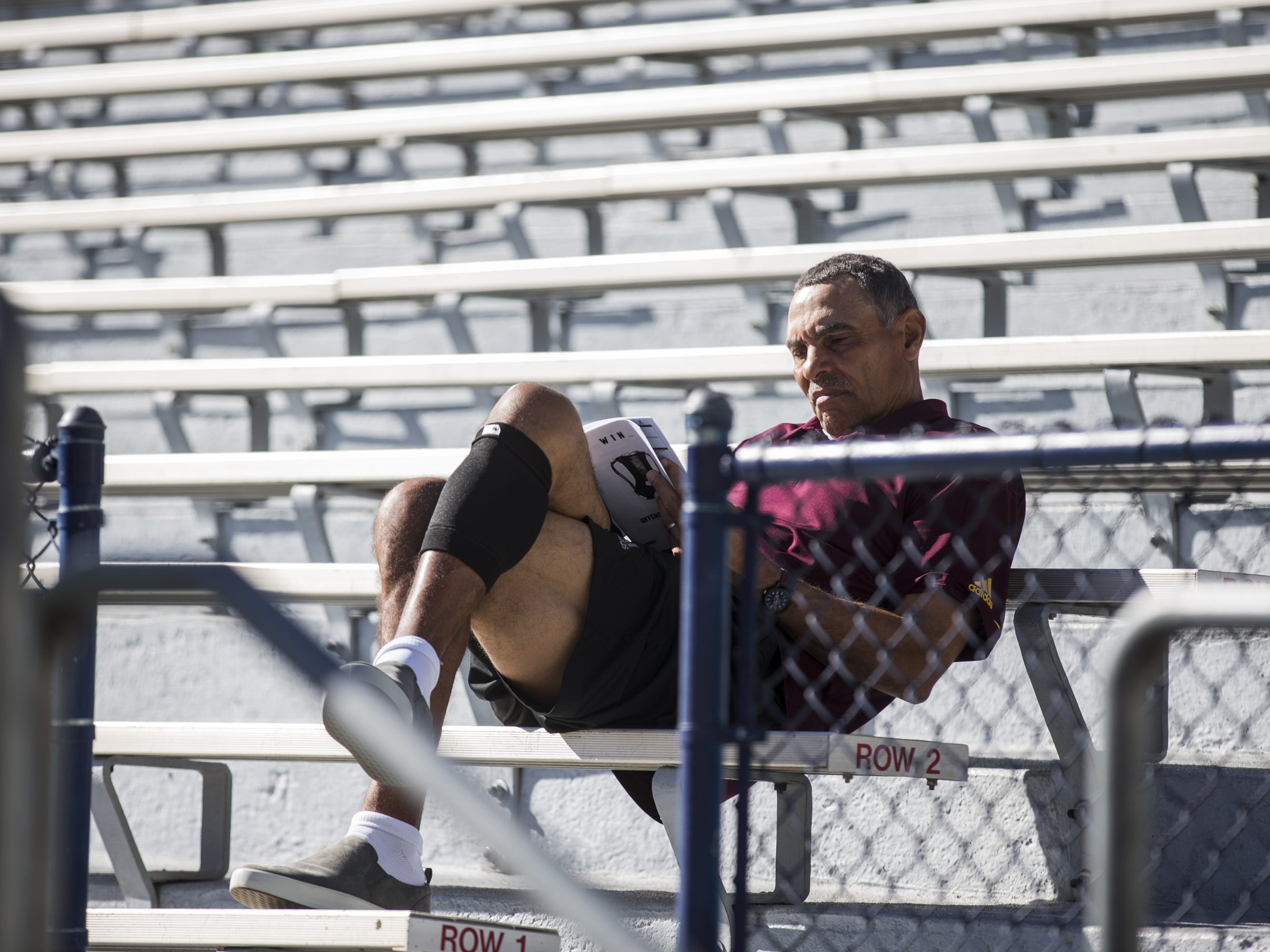Arizona State head coach Herm Edwards sits on the bleachers before the Territorial Cup football game on Saturday, Nov. 24, 2018, at Arizona Stadium in Tucson, Ariz.