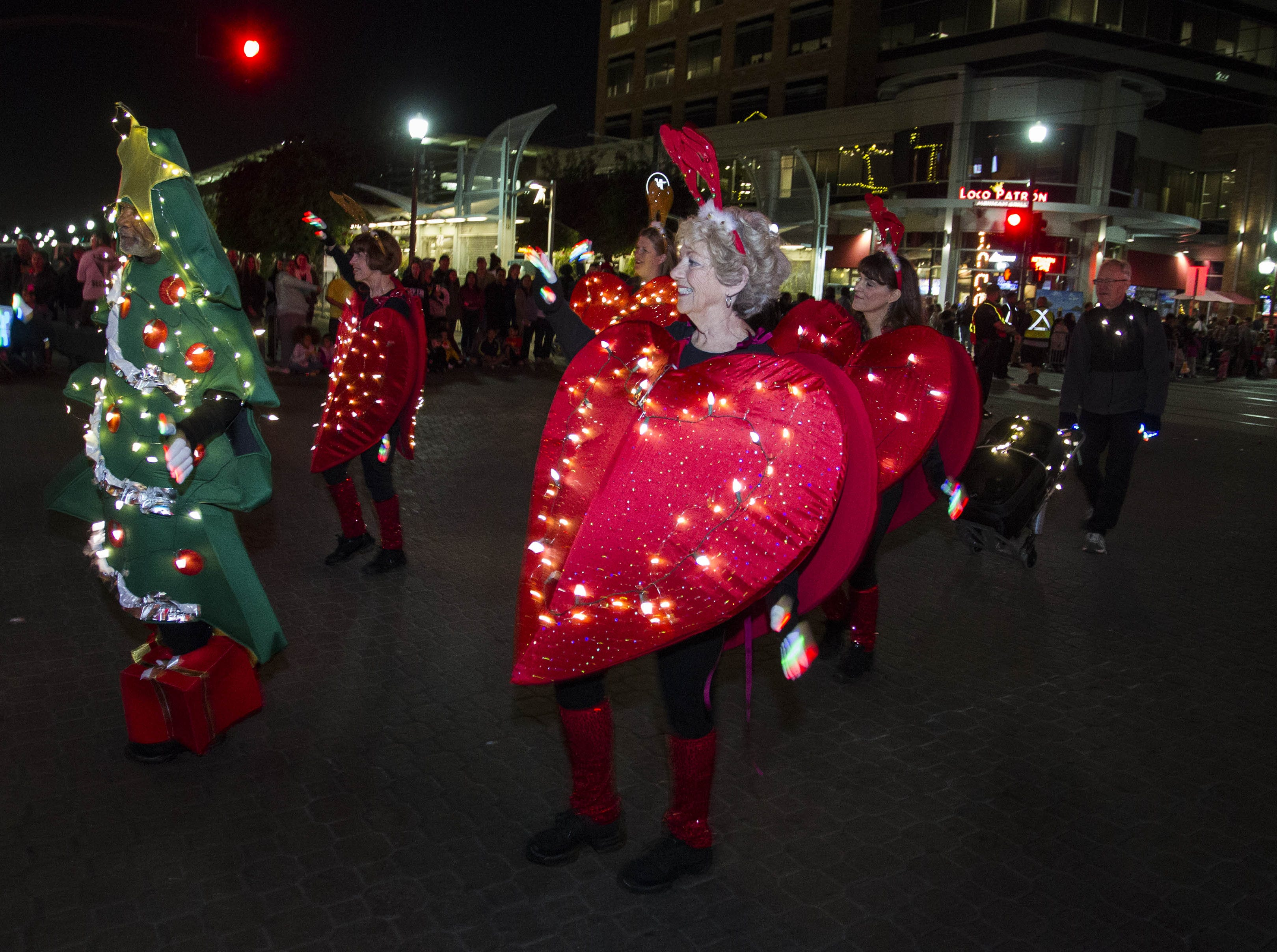 Parade participants entertain the crowd during the 2018 Fantasy of Lights Parade on Mill Avenue, Friday, Nov. 23, 2018.