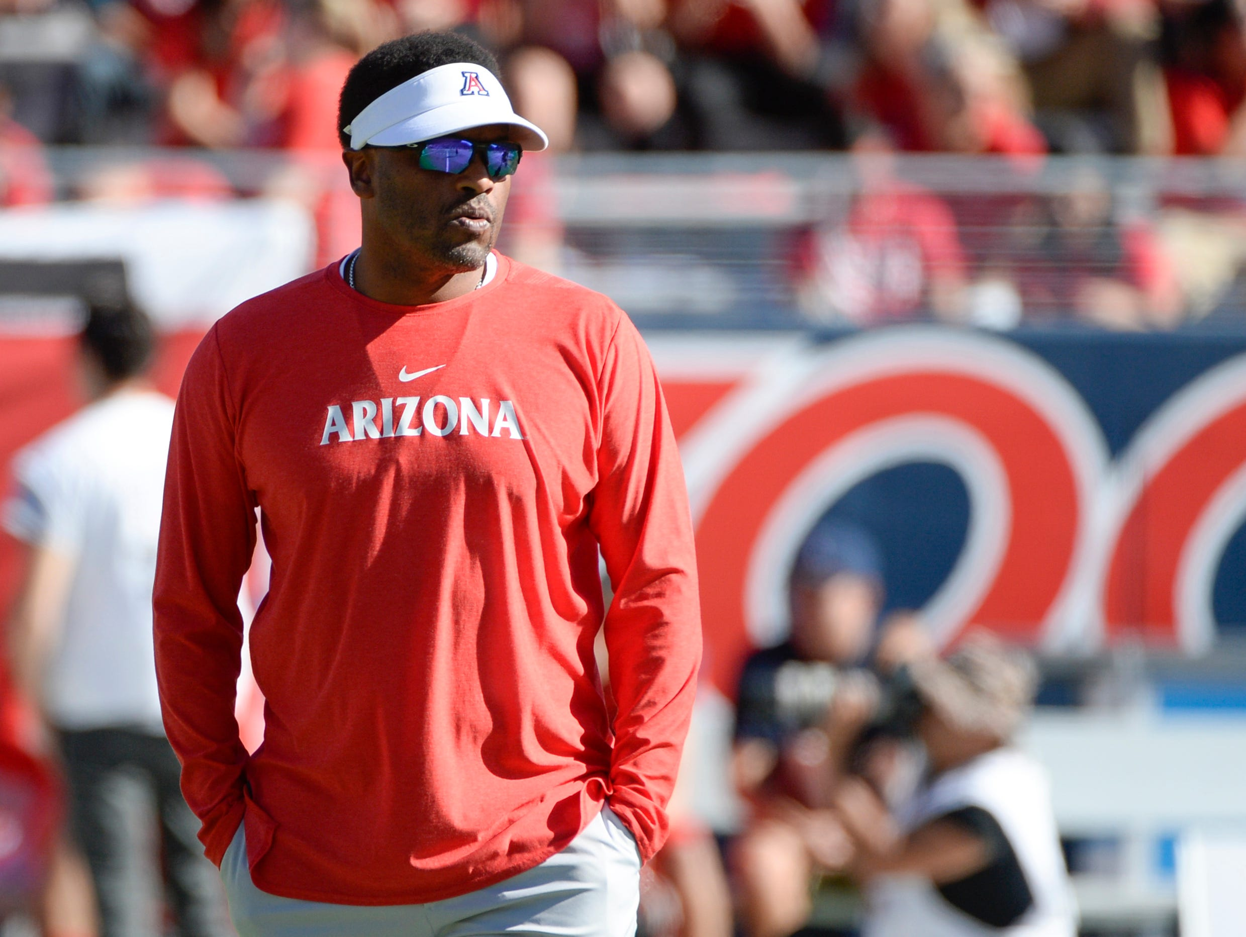 Nov 24, 2018; Tucson, AZ, USA; Arizona Wildcats head coach Kevin Sumlin watches as his team warms up before playing the Arizona State Sun Devils at Arizona Stadium. Mandatory Credit: Casey Sapio-USA TODAY Sports