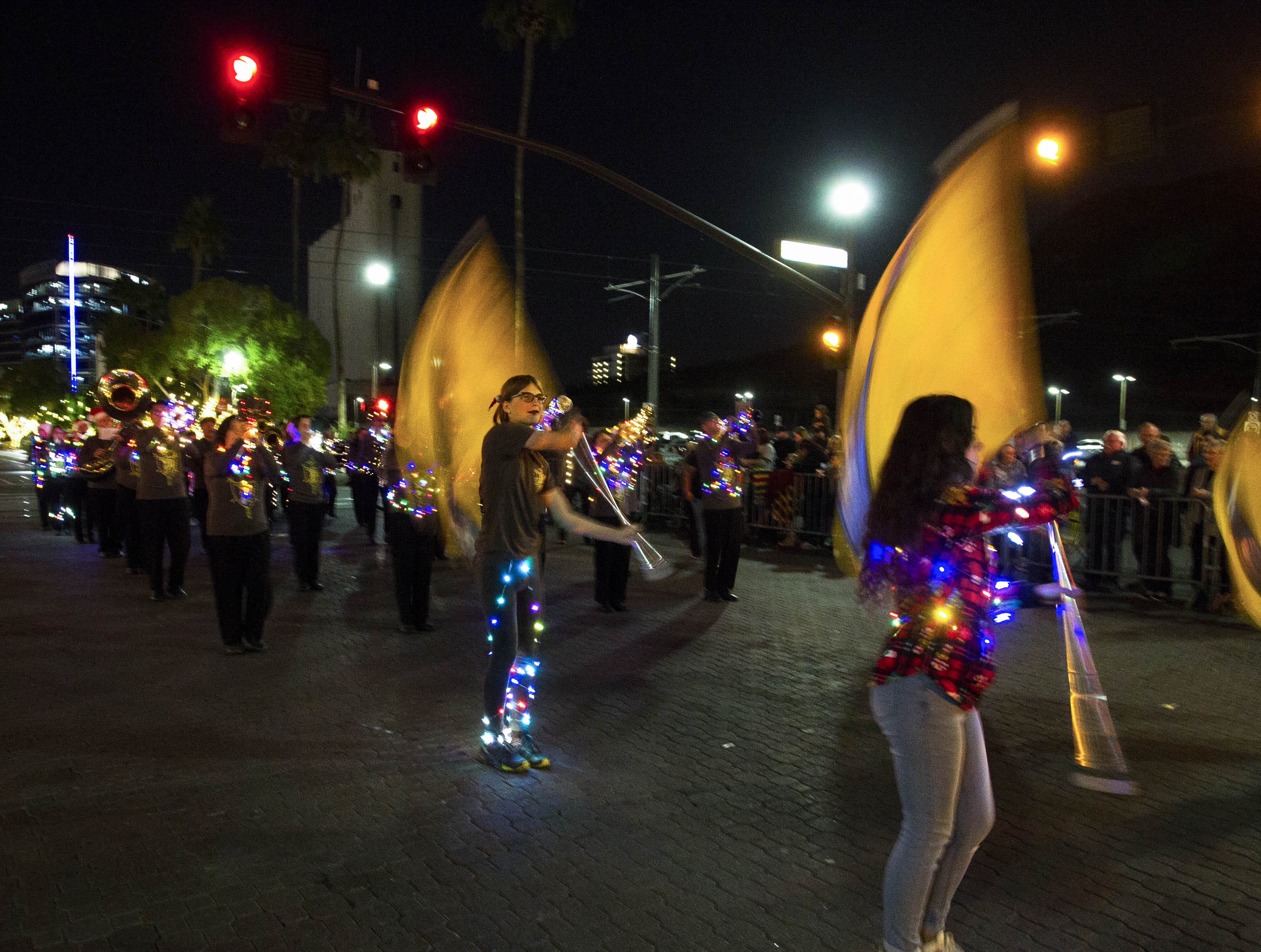 Marcos de Niza's band entertains the crowd during the 2018 Fantasy of Lights Parade on Mill Ave. Friday, Nov. 23, 2018.