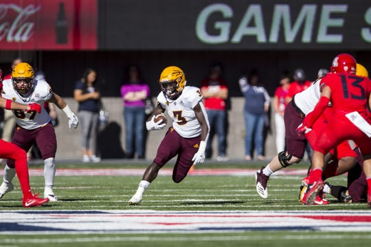 Eno Benjamin runs the ball against Arizona during the first half of the Territorial Cup on Nov. 24 at Arizona Stadium.